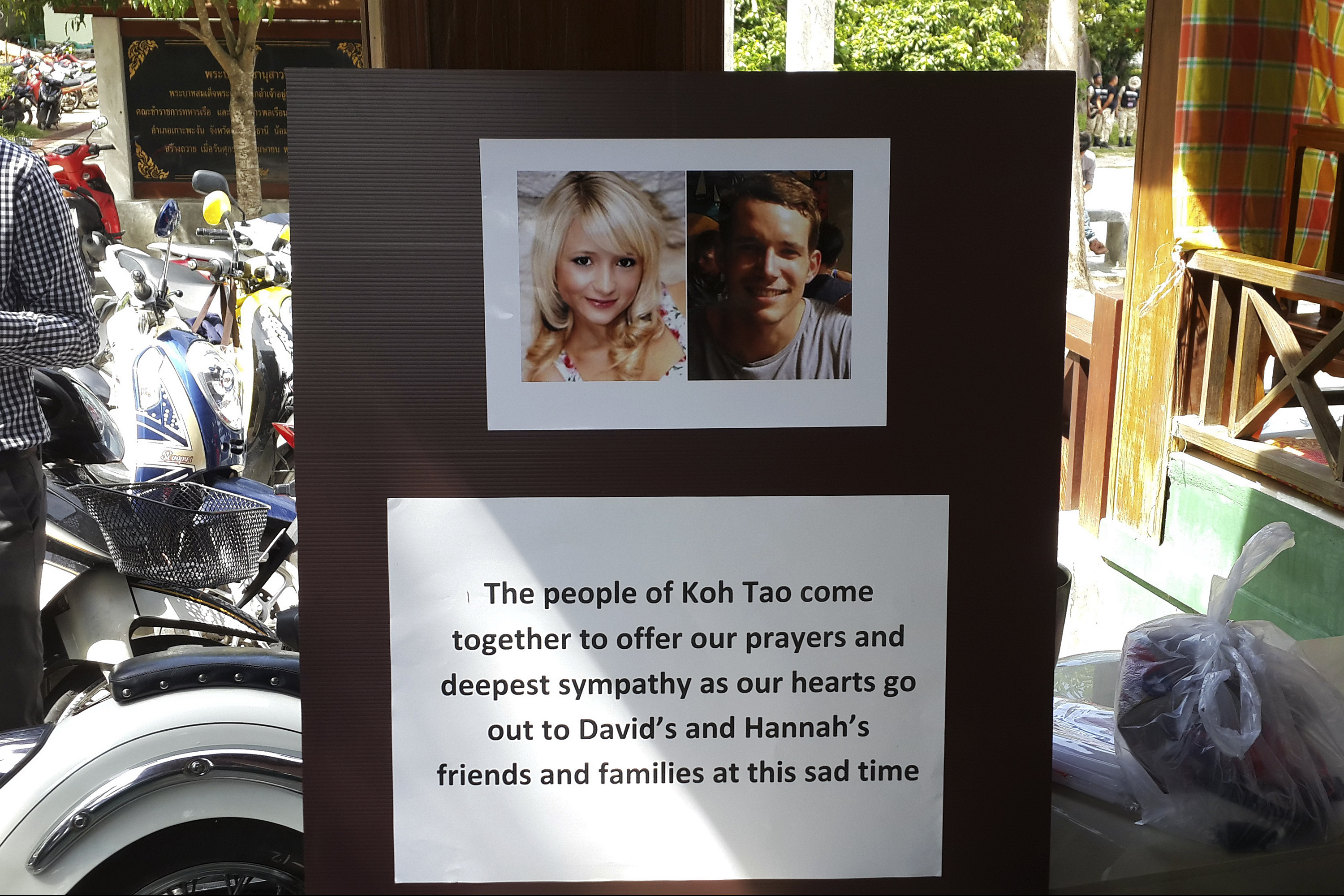 Pictures of killed British tourists David Miller and Hannah Witheridge and a message of support to their friends and families are displayed during special prayers at Koh Tao island on Sept. 18, 2014
