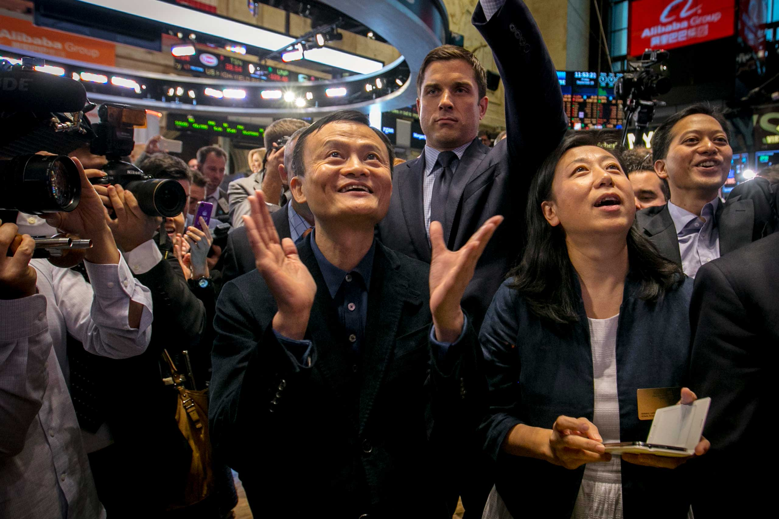 Alibaba Group Holding Ltd founder Jack Ma and Chief Financial Officer Maggie Wu react as the company's initial public offering, under the ticker  BABA , begins trading at the New York Stock Exchange in New York, Sept. 19, 2014.