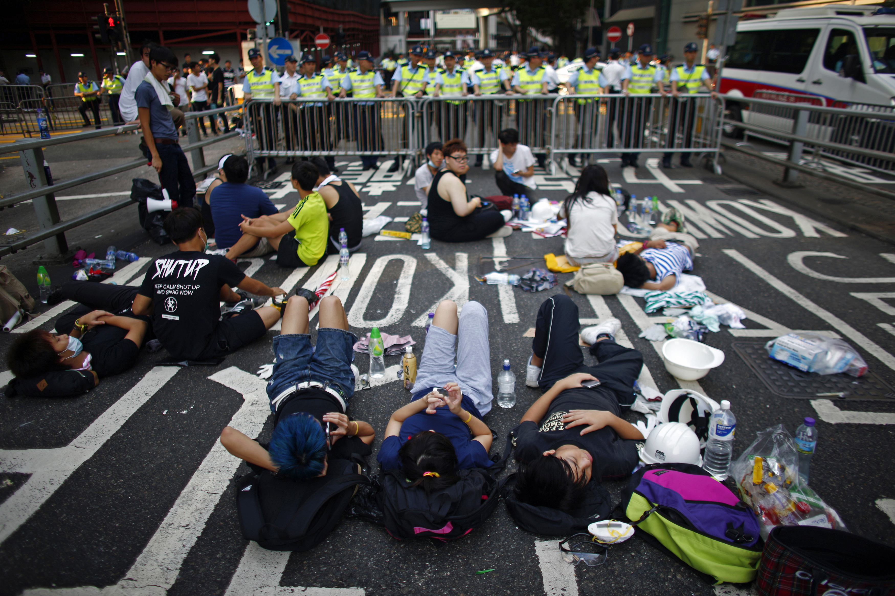 Peaceful protesters block a street near the government headquarters in Hong Kong on Sept 30, 2014