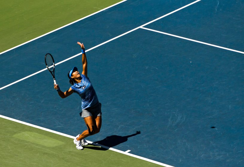 Na of China serves to Cibulkova at the Rogers Cup tennis tournament in Toronto