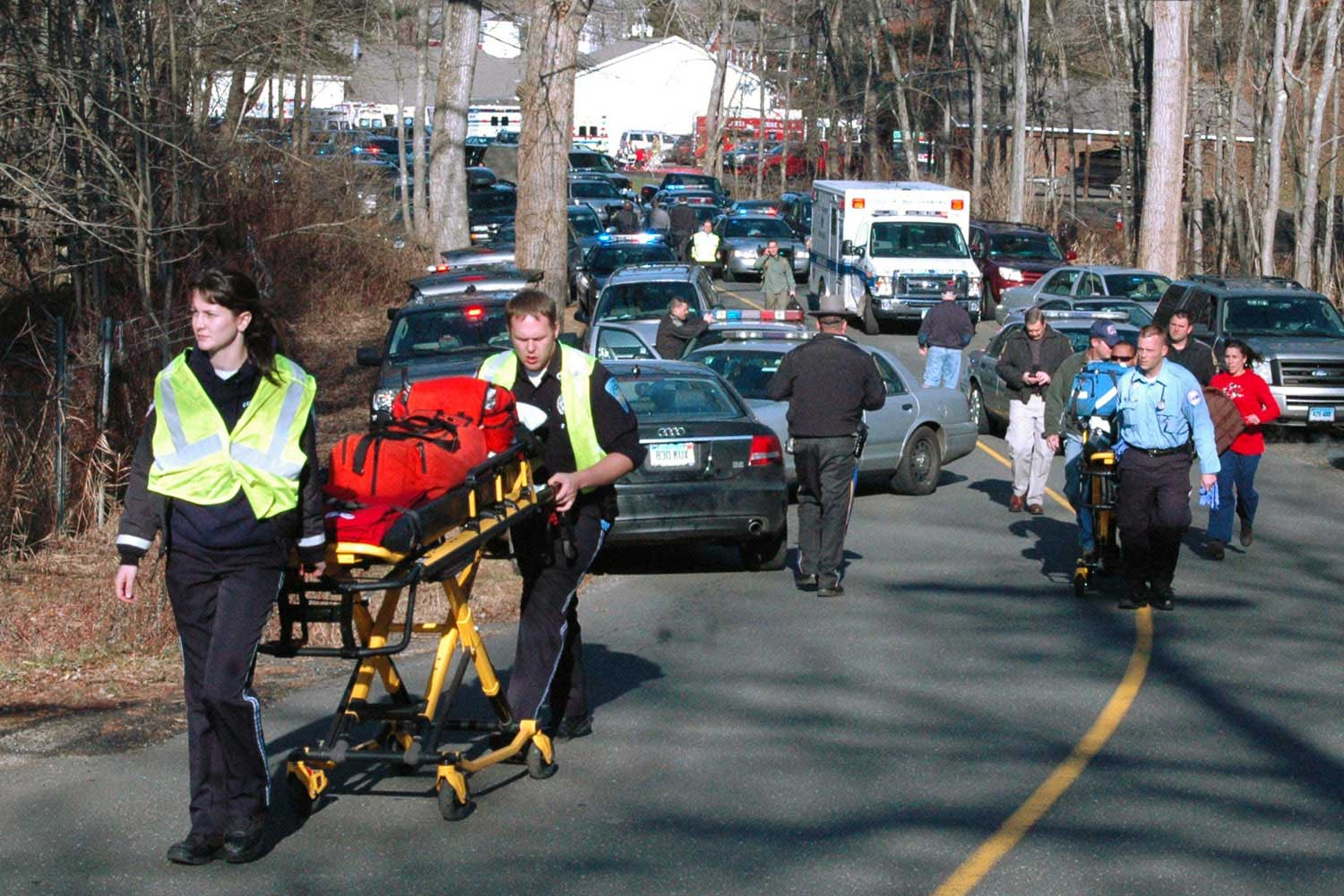 Paramedics push stretchers toward Sandy Hook Elementary School in Newtown, Conn., where 20-year-old Adam Lanza opened fire, killing 26 people, including 20 children.