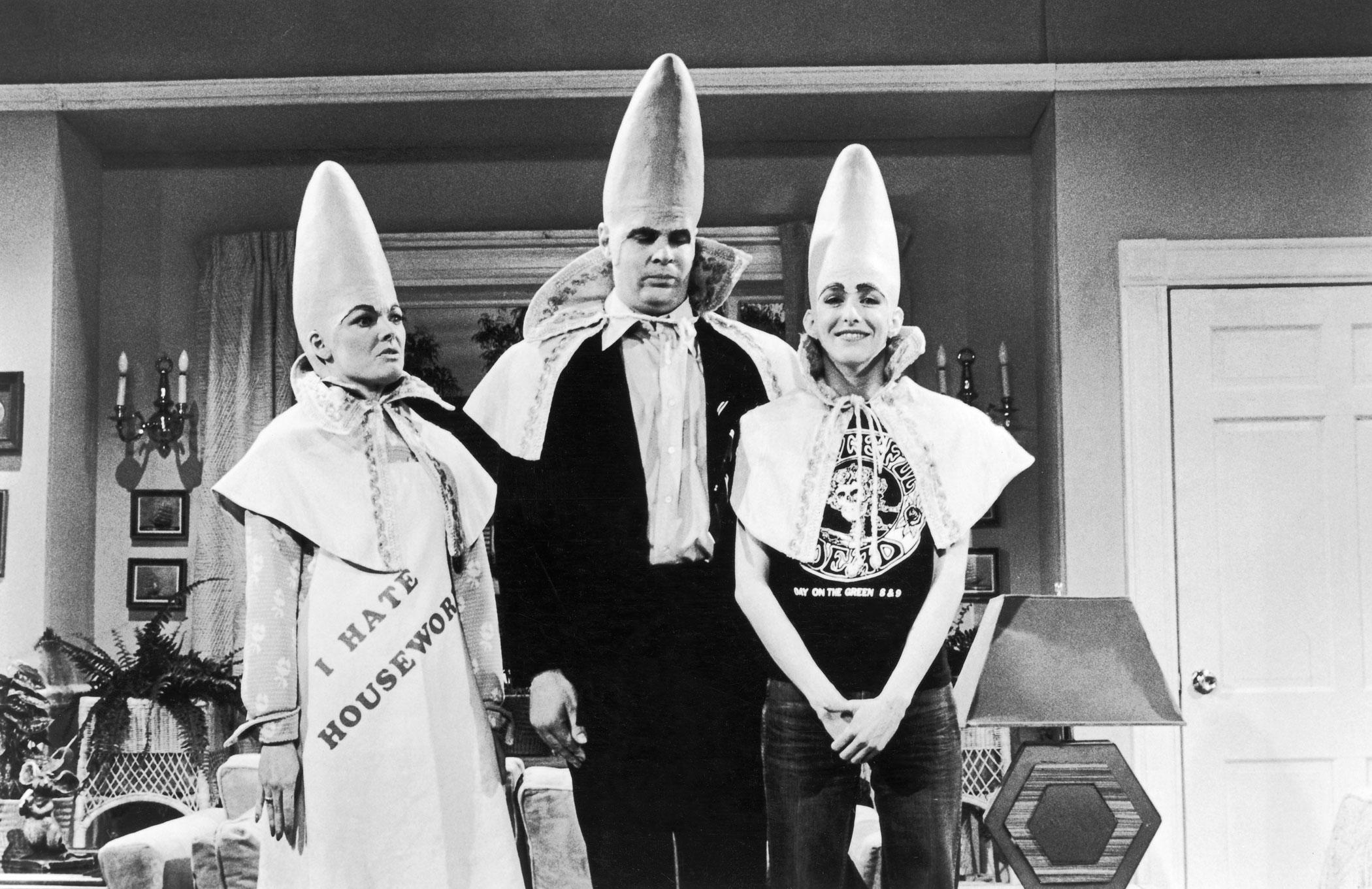 Jane Curtin, left, Dan Aykroyd and Laraine Newman, in their skit 'The Coneheads' circa 1970s.