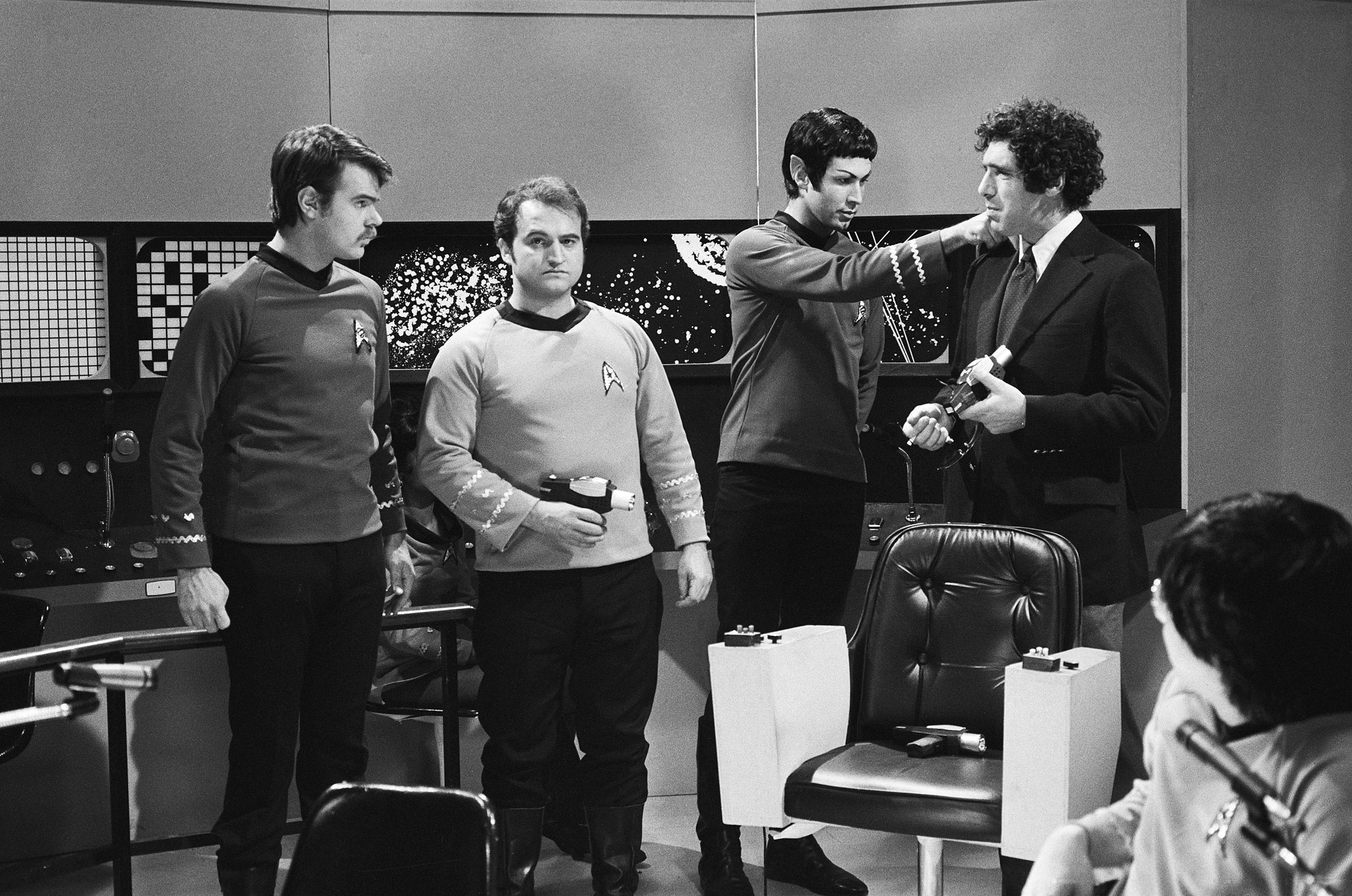 "Dan Aykroyd as Dr. McCoy, John Belushi as Captain Kirk, Chevy Chase as Mr. Spock, Elliott Gould as Herb Goodman and Akira Yoshimura as Mr. Sulu during ""The Last Voyage of the Starship Enterprise"" skit on May 29, 1976."