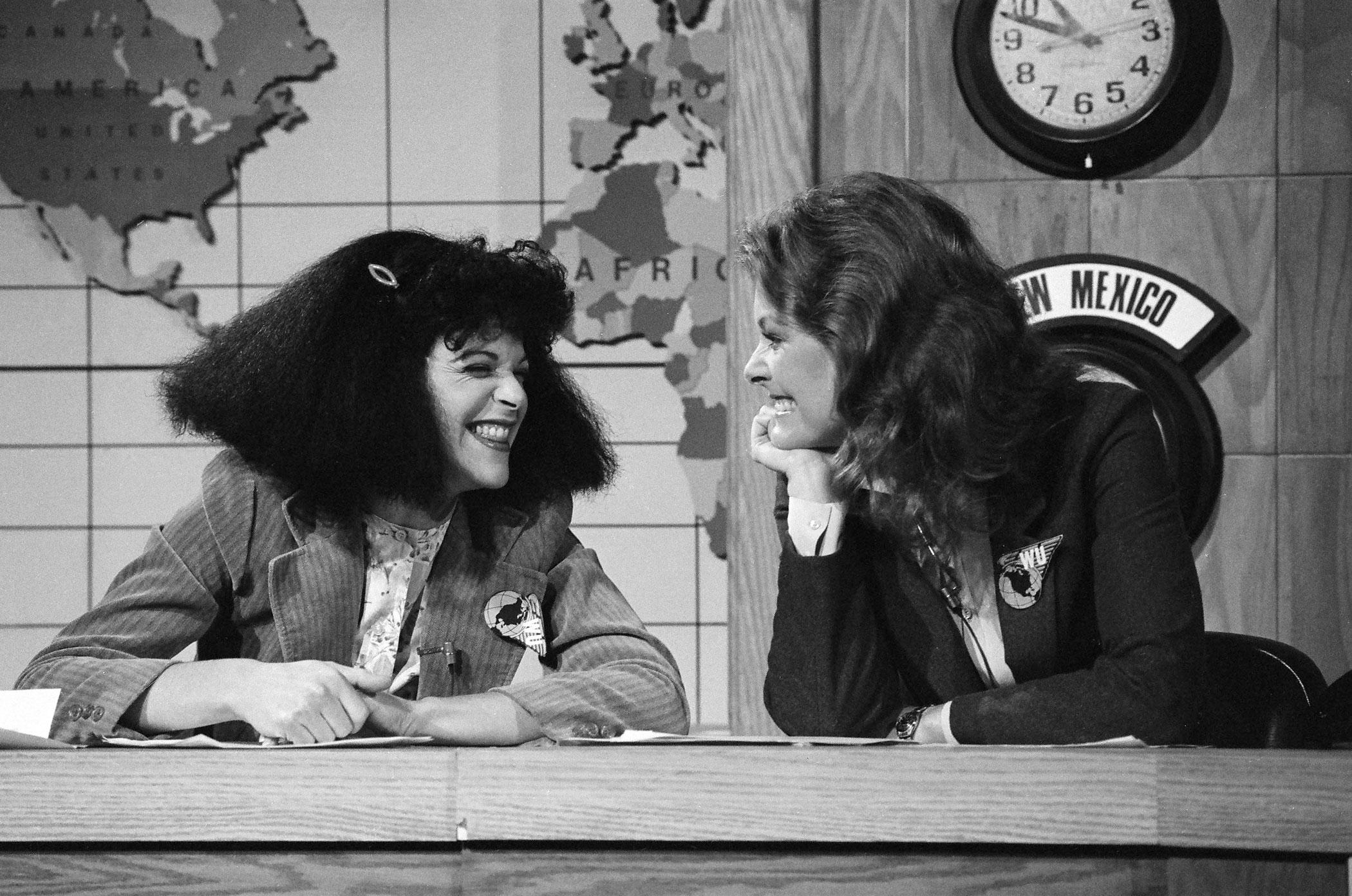 Gilda Radner as Roseanne Roseannadanna and Jane Curtin during the 'Weekend Update' skit on October 20, 1979 .