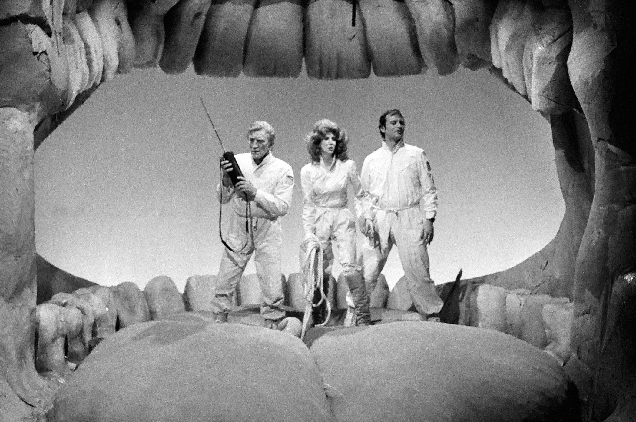 Kirk Douglas as Colonel Lloyd D. Westman, Laraine Newman as Nicole Westman and Bill Murray as Captain Steve McCleod during the 'The Micro-Dentists' skit on February 23, 1980.