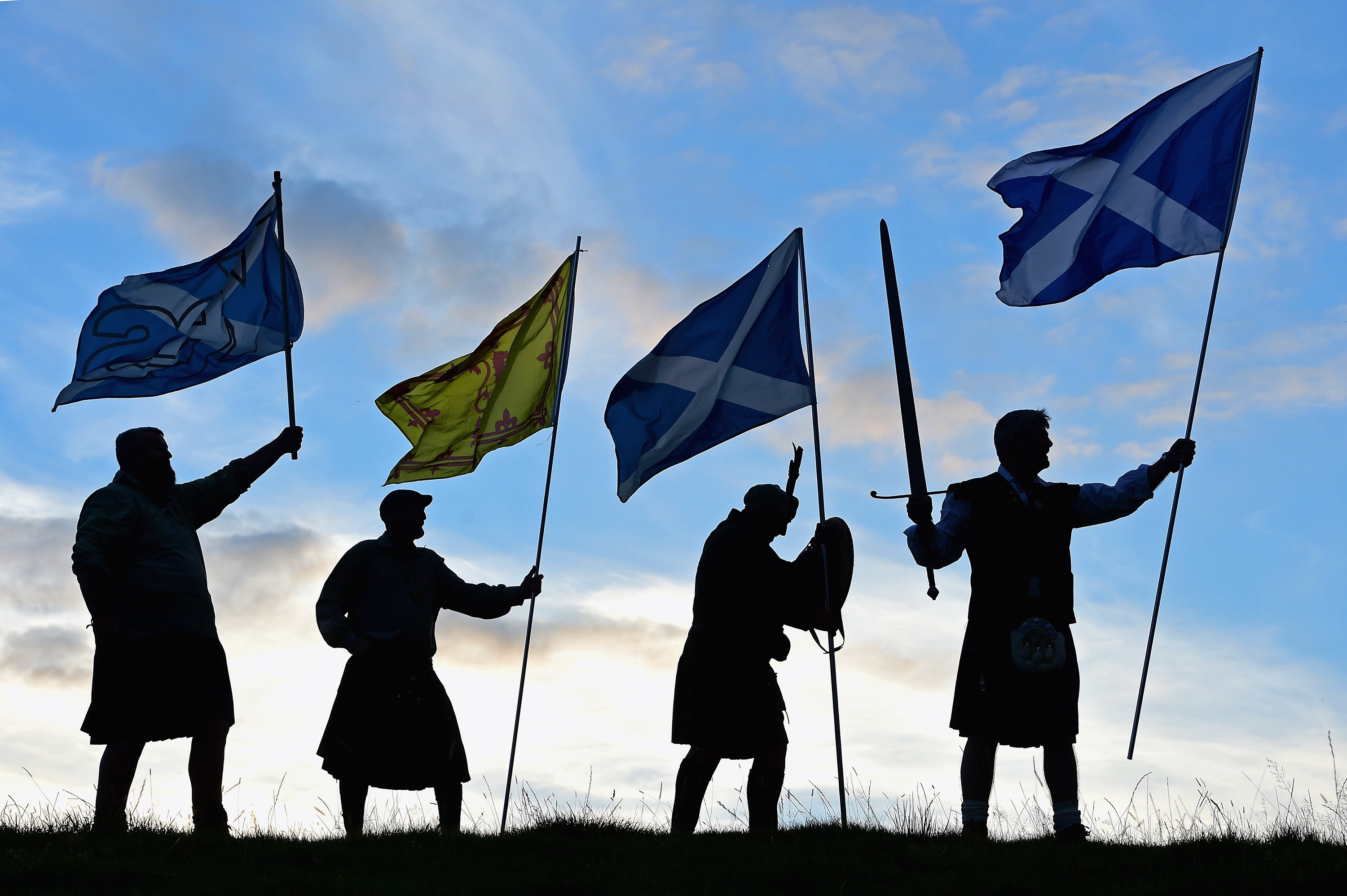 Duncan Thomson, Brian McCutcheon, John Patterson and Arthur Murdoch,from King of Scots Robert the Bruce Society, hold the Scottish flags as they prepare to vote in the Scottish independence referendum on Sept. 14, 2014 in Loch Lomond, Scotland.