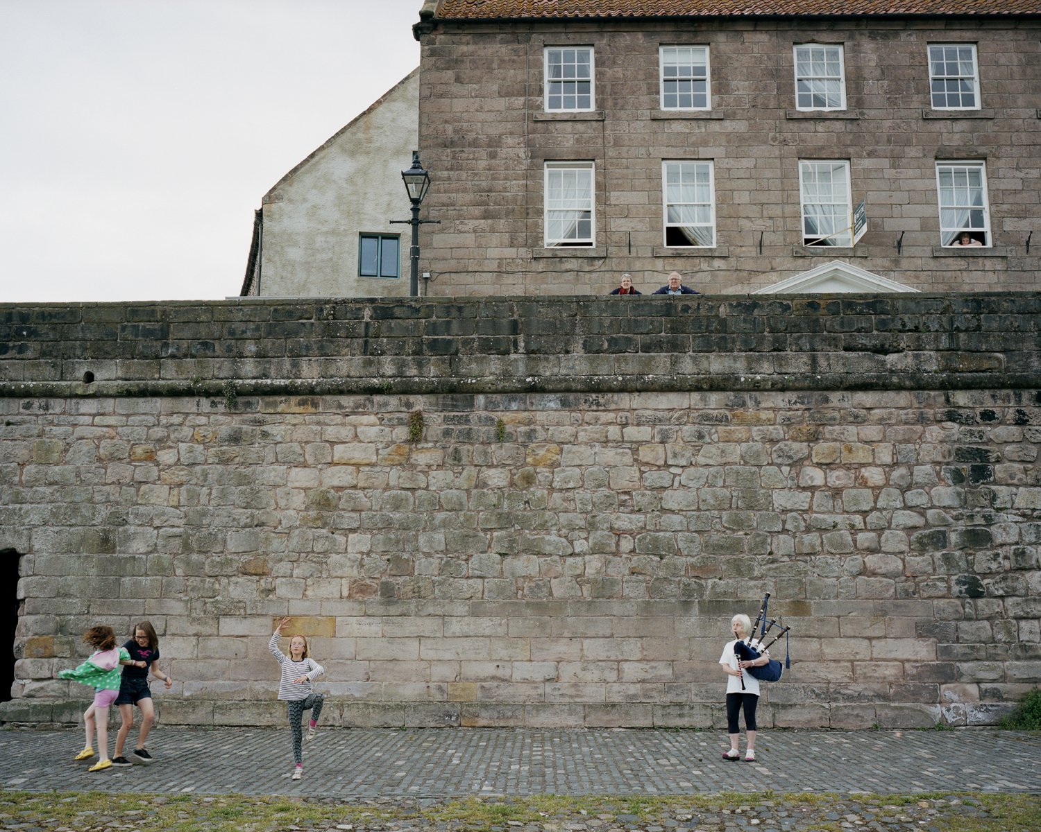 Iris playing bagpipes outside Berwick-Upon-Tweed's town walls, which were built in the early 14th century under Edward I, following his capture of the city from the Scots.