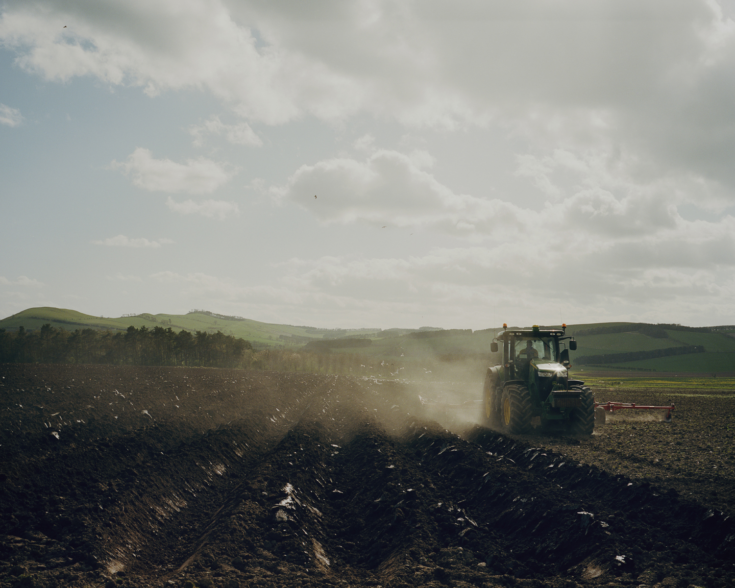 A farmer ploughing the land, Northumberland, England.