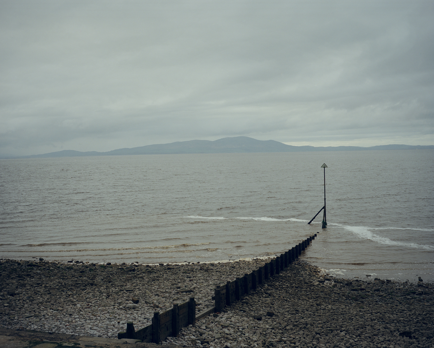 Looking at the hills of Dumfriesshire in Scotland from Cumbria, England, across the Solway Firth.