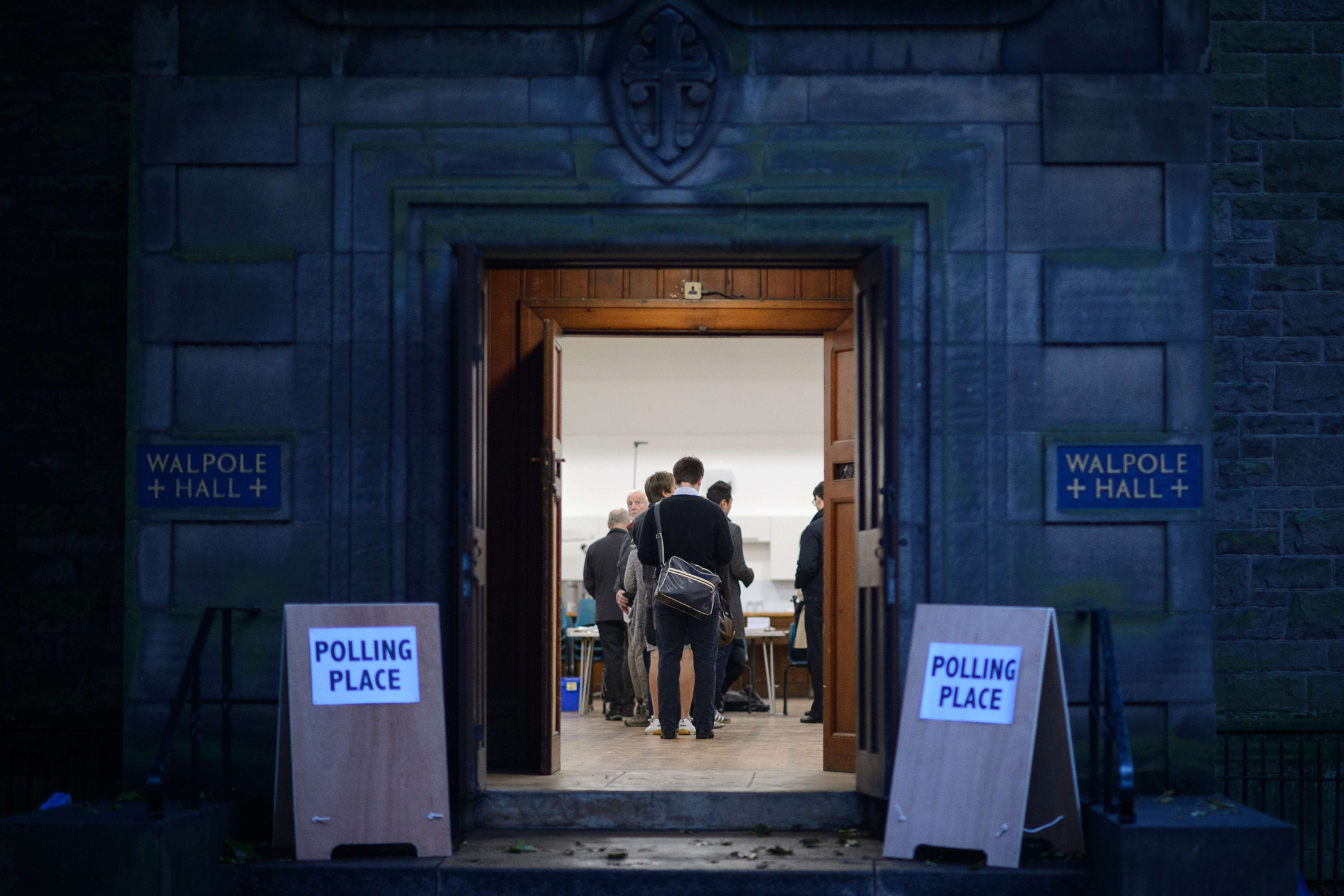 People wait to cast their votes inside a polling station in Edinburgh, Scotland, on Sept. 18, 2014, during a referendum on Scotland's independence.