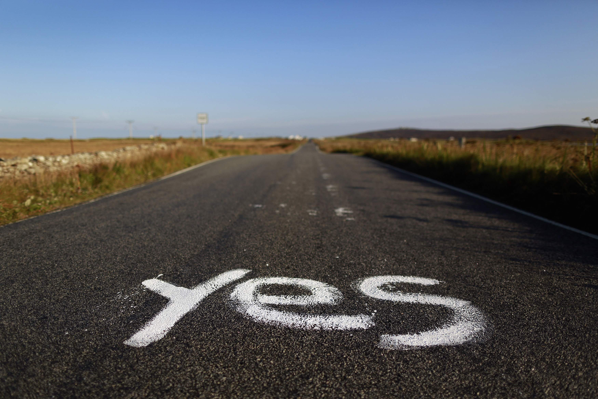 Graffiti supporting the  Yes  campaign is painted on a road in North Uist in the Outer Hebrides, Sept. 17, 2014.