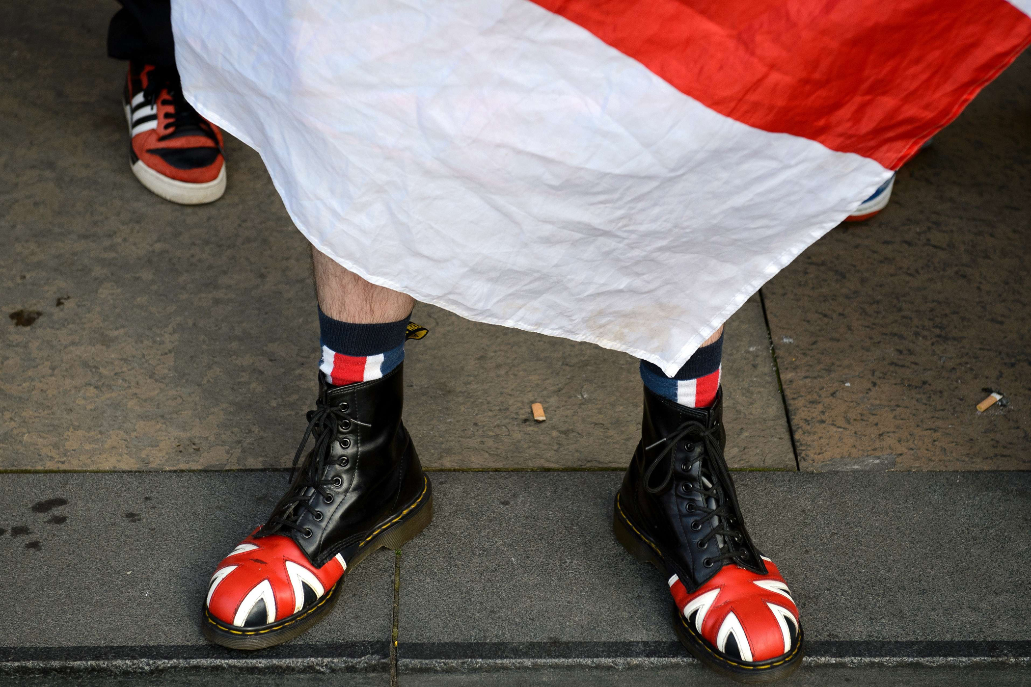 An anti-independence activist wearing shoes bearing the Union flag rallies opposite pro-independence supporters in Glasgow's George Square, in Scotland, on Sept. 17, 2014, on the eve of Scotland's independence referendum.