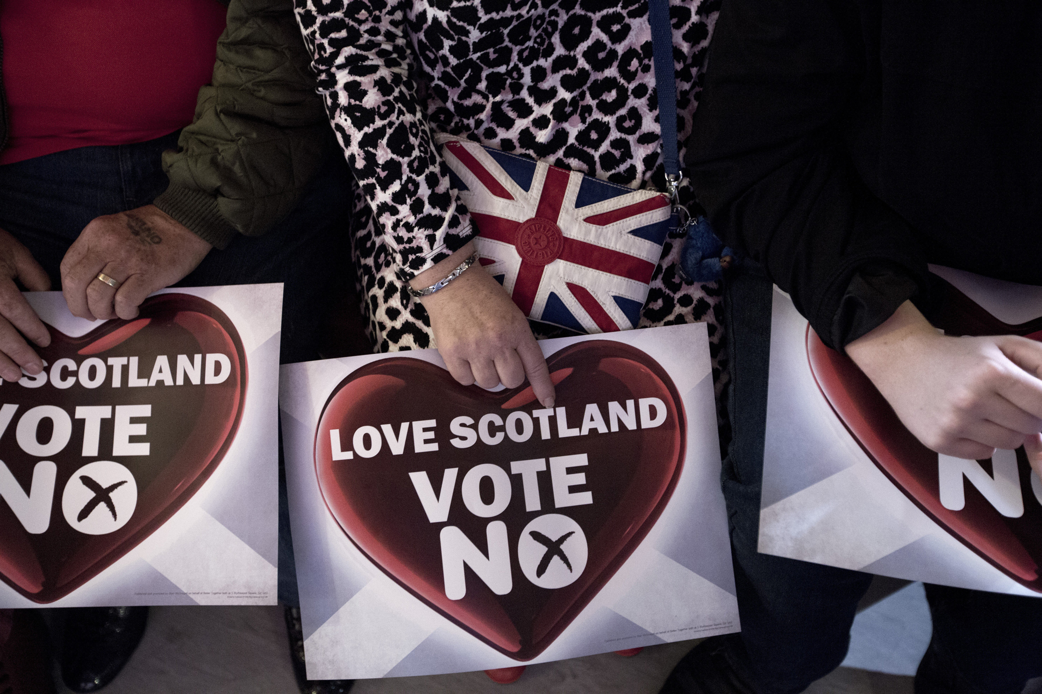 A woman with a 'Vote No' sign and a bag bearing a British flag, at an anti-Scottish independence Better Together rally at Community Central Hall, Glasgow, Sept. 17, 2014.