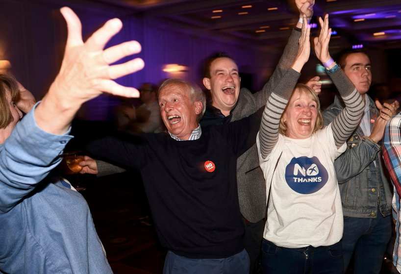 "Supporters from the ""No"" Campaign react to a declaration in their favour, at the Better Together Campaign headquarters in Glasgow, Scotland, Sept. 19, 2014."