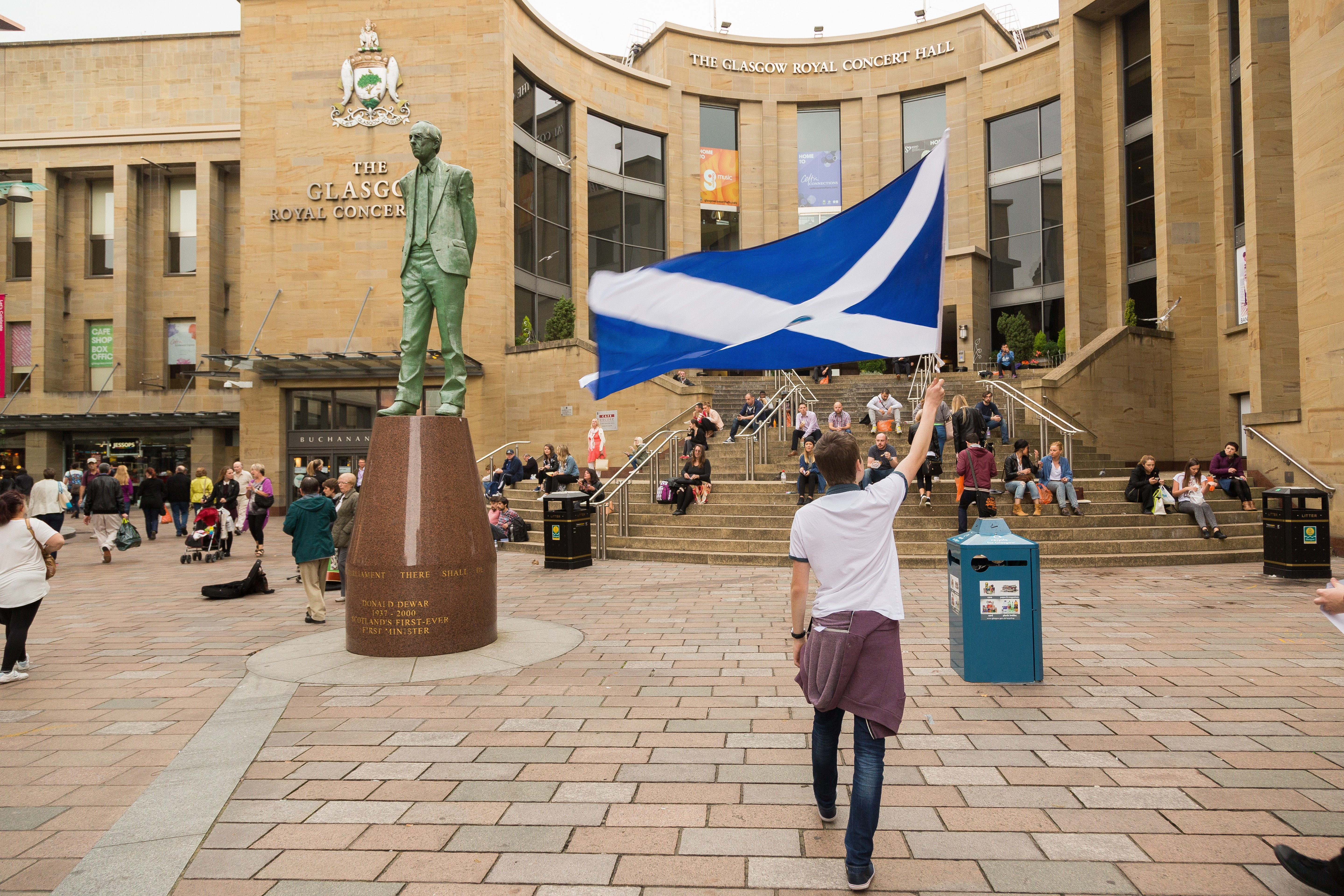 A Yes campaign supporter flies a large Scotland flag close to the statue of Donald Dewar in Buchanan Street on Sept. 4, 2014.