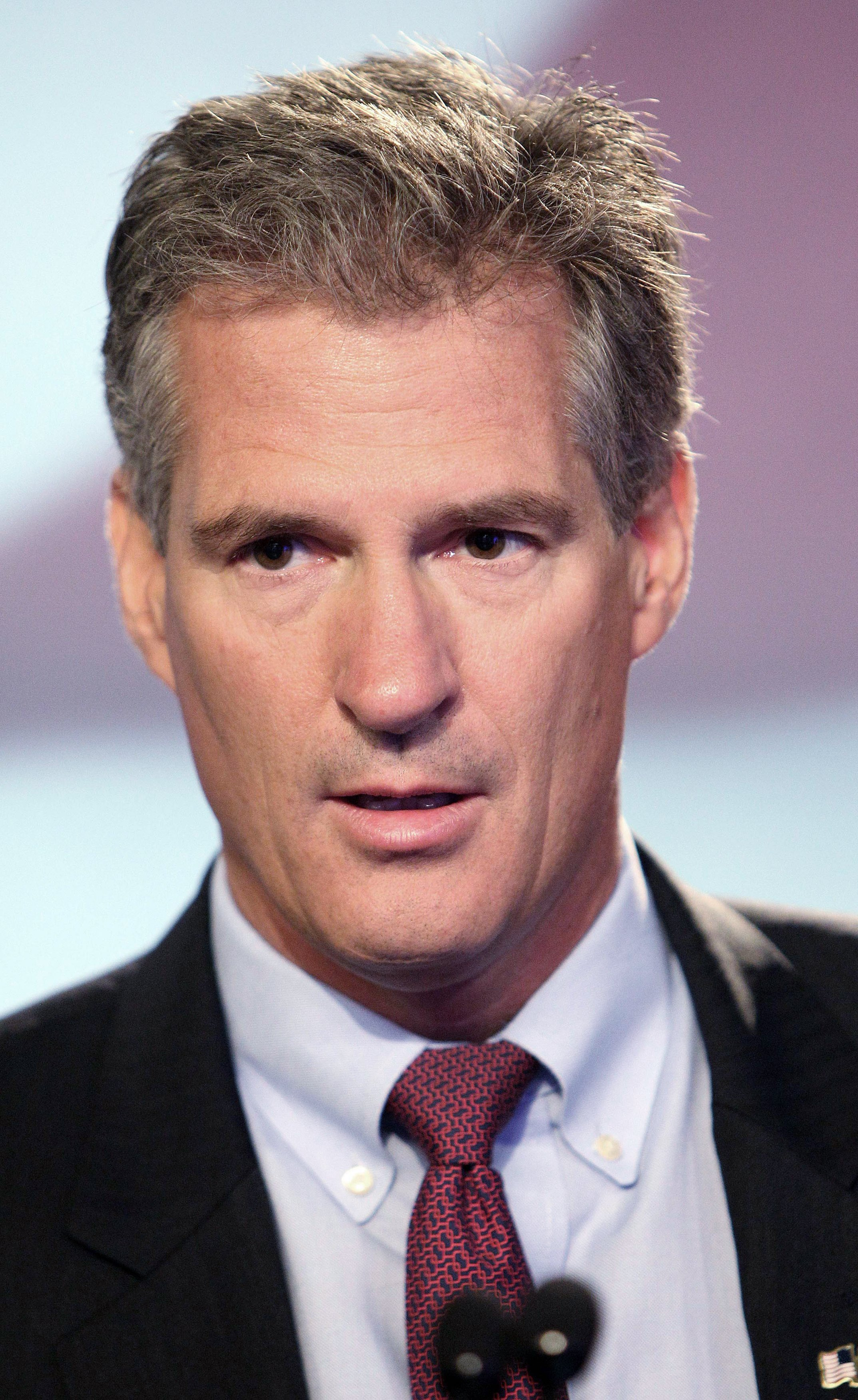 Former Republican U.S. Sen. of Mass. Scott Brown waits before a televised debate on Sept. 4, 2014 at WMUR in Manchester, N.H.