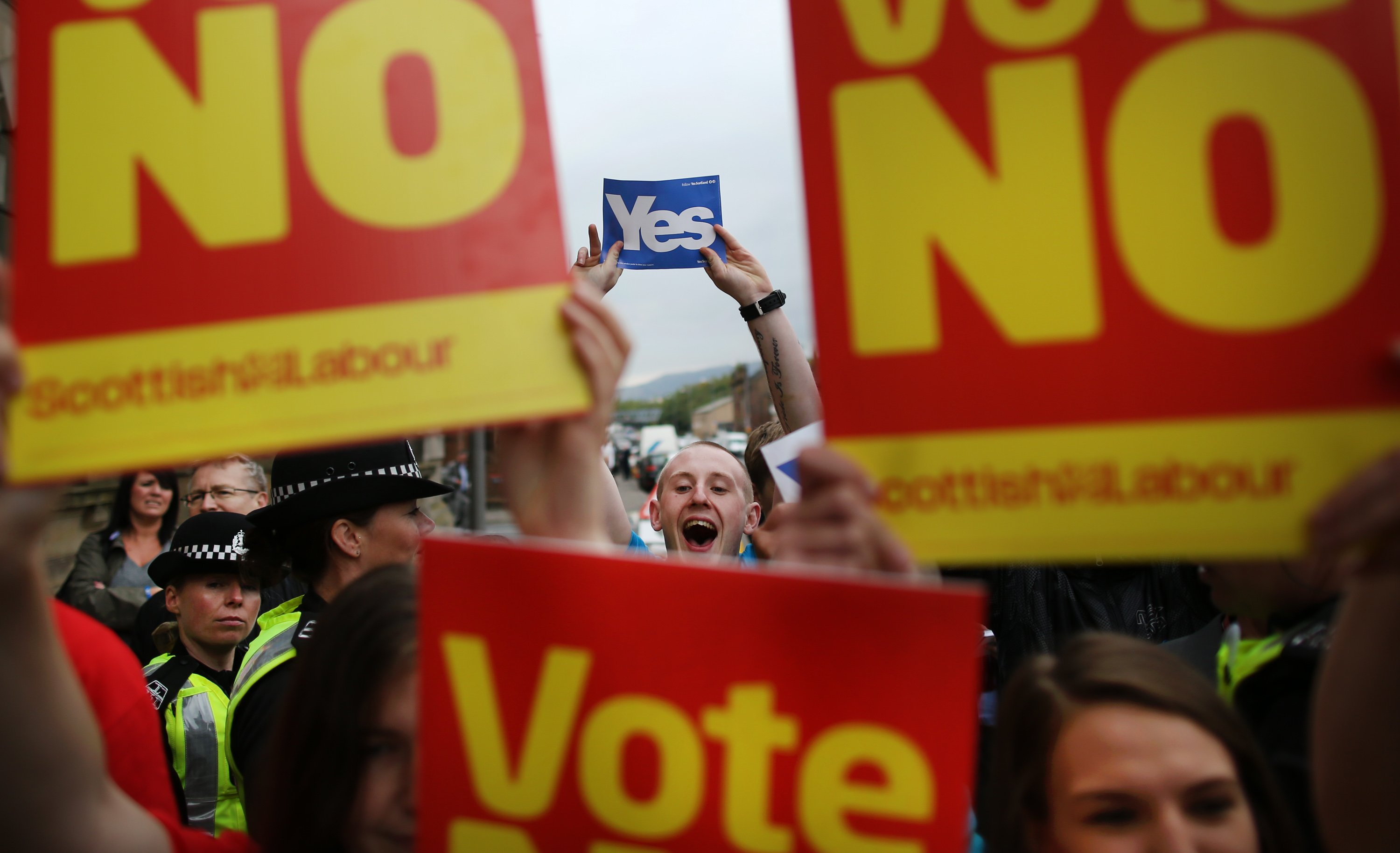 Yes campaigners stand near No supporters at Dumbarton Town Hall as former Prime Minister Gordon Brown leaves after attending a rally on Sept. 16, 2014 in Glasgow, Scotland.