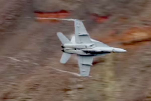 An F-18 shows its belly to an appreciative cameraman on a recent flight through Death Valley.