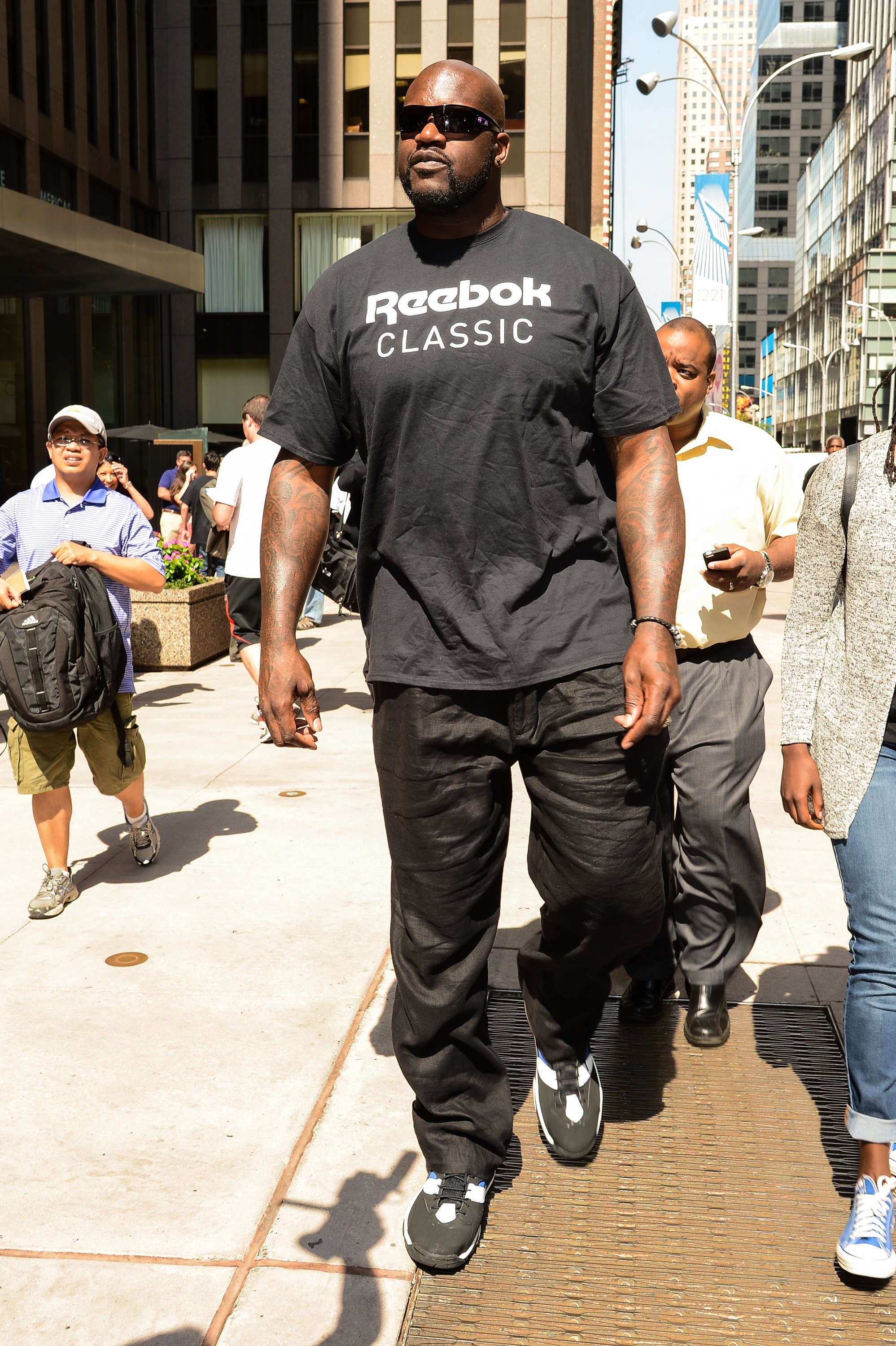 Television personality and former professional basketball player Shaquille O'Neal leaves the Sirius XM Studios in New York City on Aug. 11, 2014.