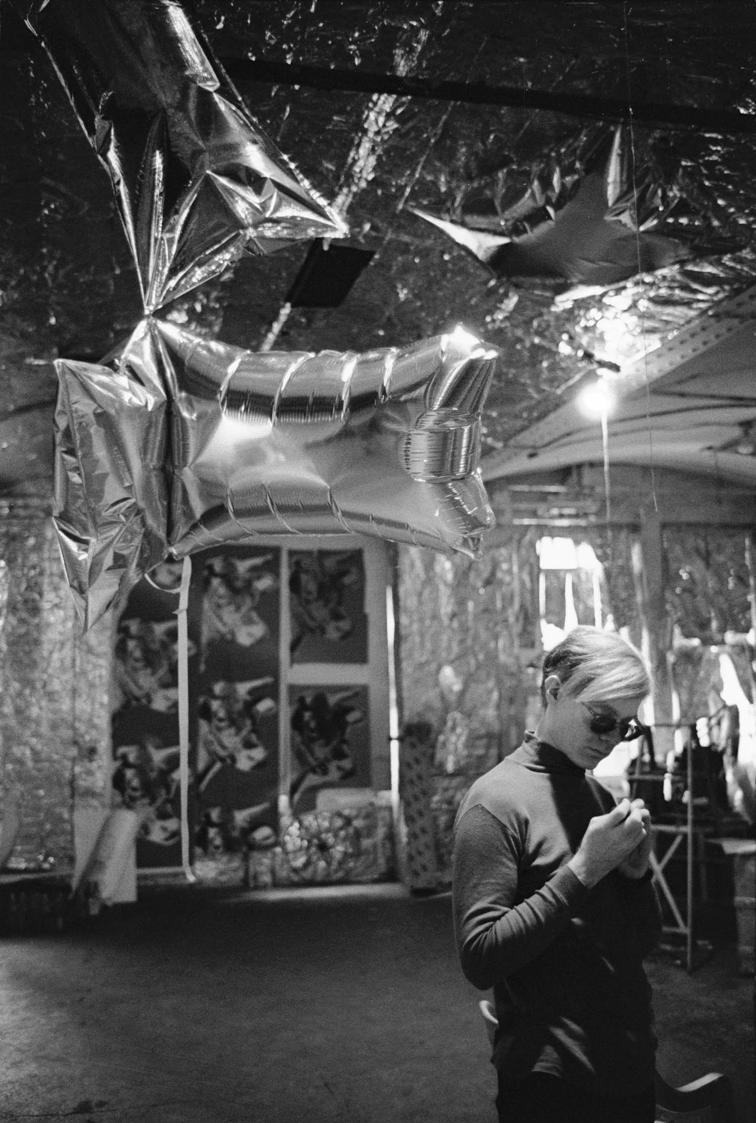 Warhol with 'Silver Clouds' in Factory
