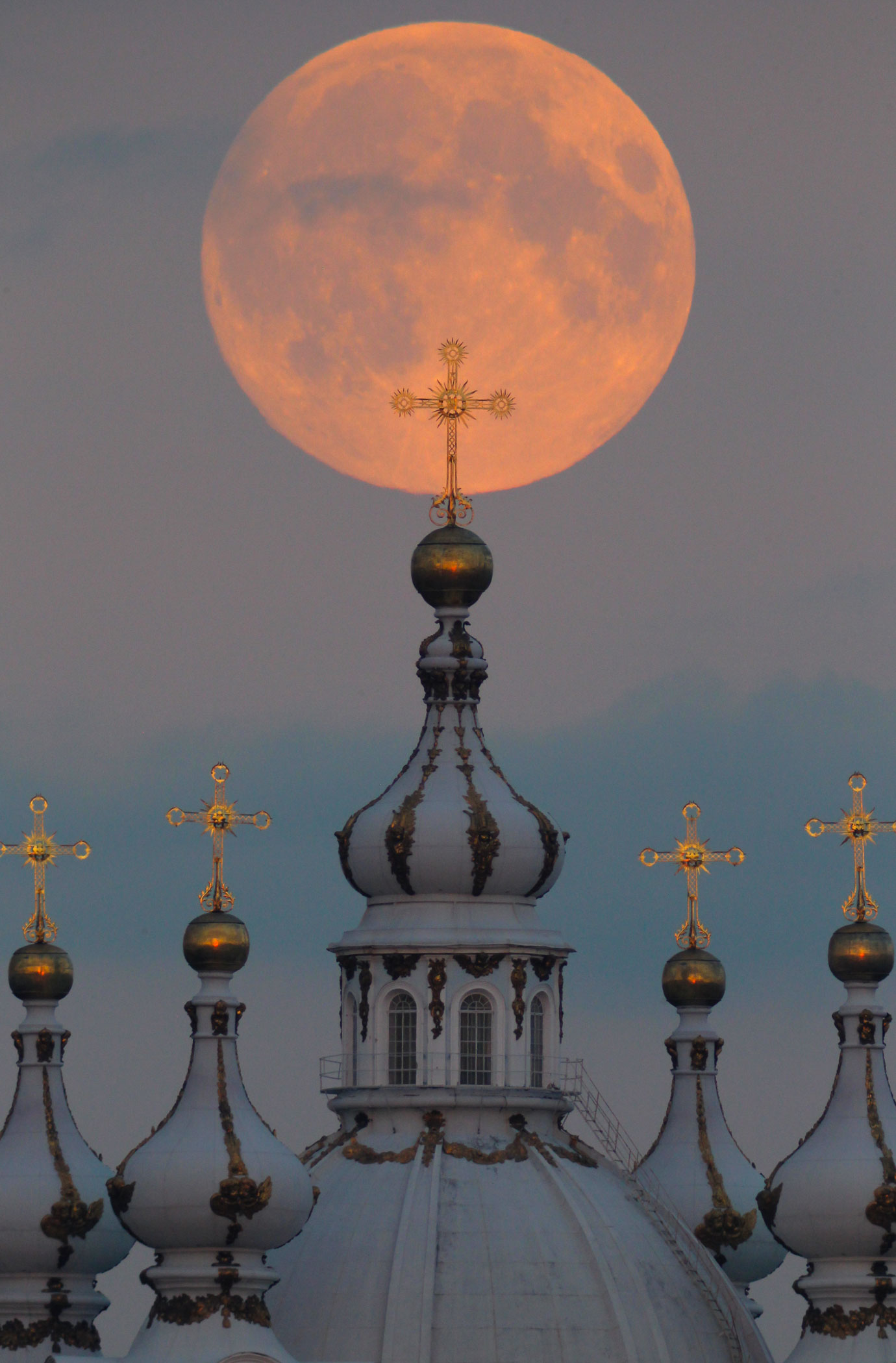The harvest supermoon above the domes of the Smolny Cathedral in St.Petersburg, Russia, on Sept. 8, 2014.