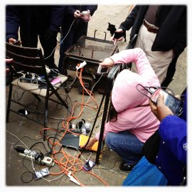New Yorkers charge their mobile phones with generators provided by Percy's Tavern, located on Avenue A and 13th Street in Manhattan