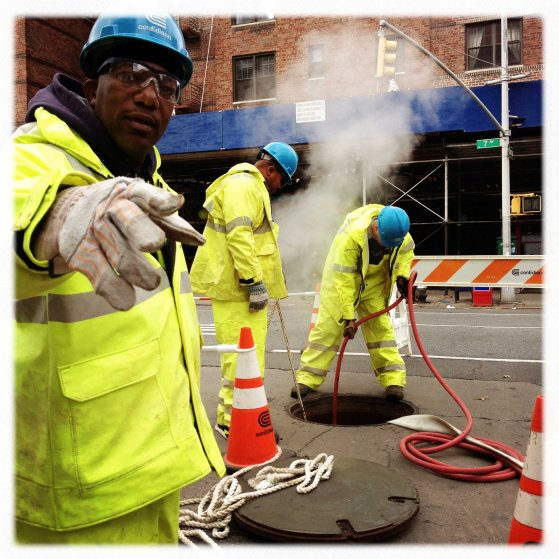 Con Edison workers clean a manhole on 7th Avenue and 22nd Street in Manhattan
