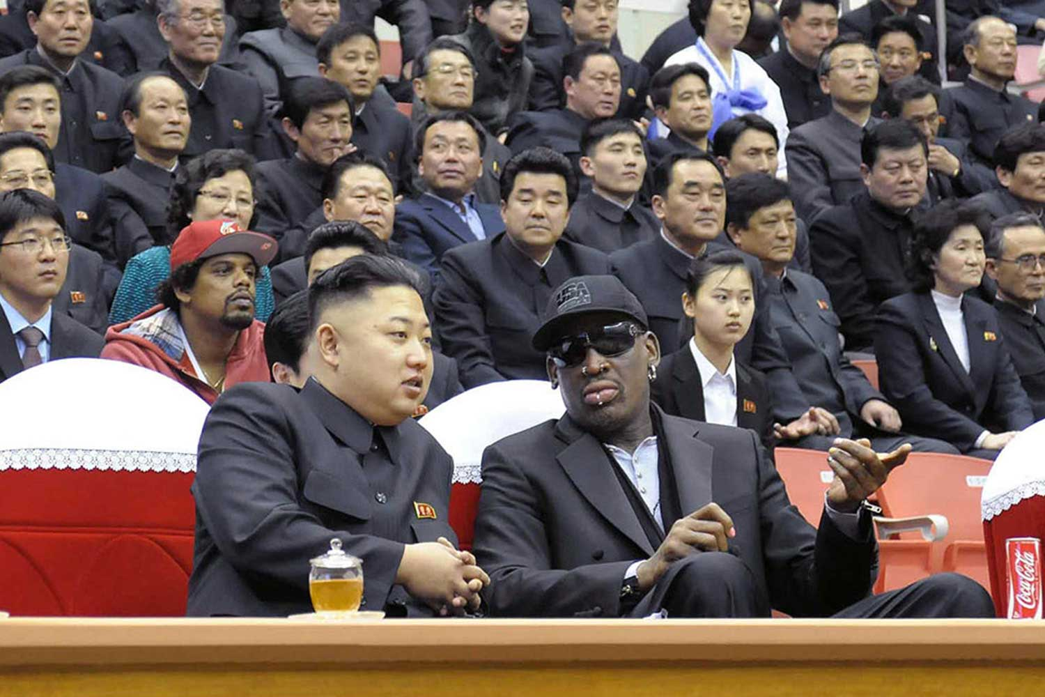 North Korean leader Kim Jong-Un and former NBA star Dennis Rodman speak at a basketball game in Pyongyang on Feb. 28, 2013.