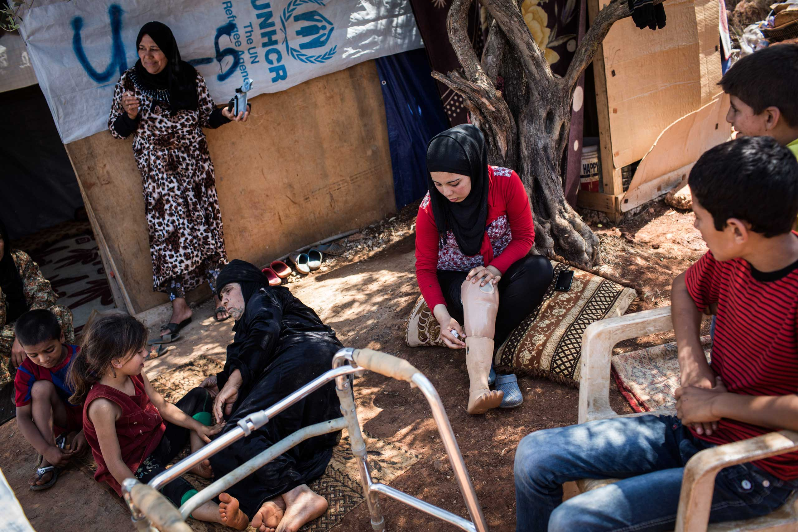 Fatima, 15, at an informal settlement near Tripoli, Lebanon, June 24, 2014. She was going to Homs in 2011 with her father and brother when a bomb fell. She was depressed after receiving an ill-fitting prosthetic but later got a better one.