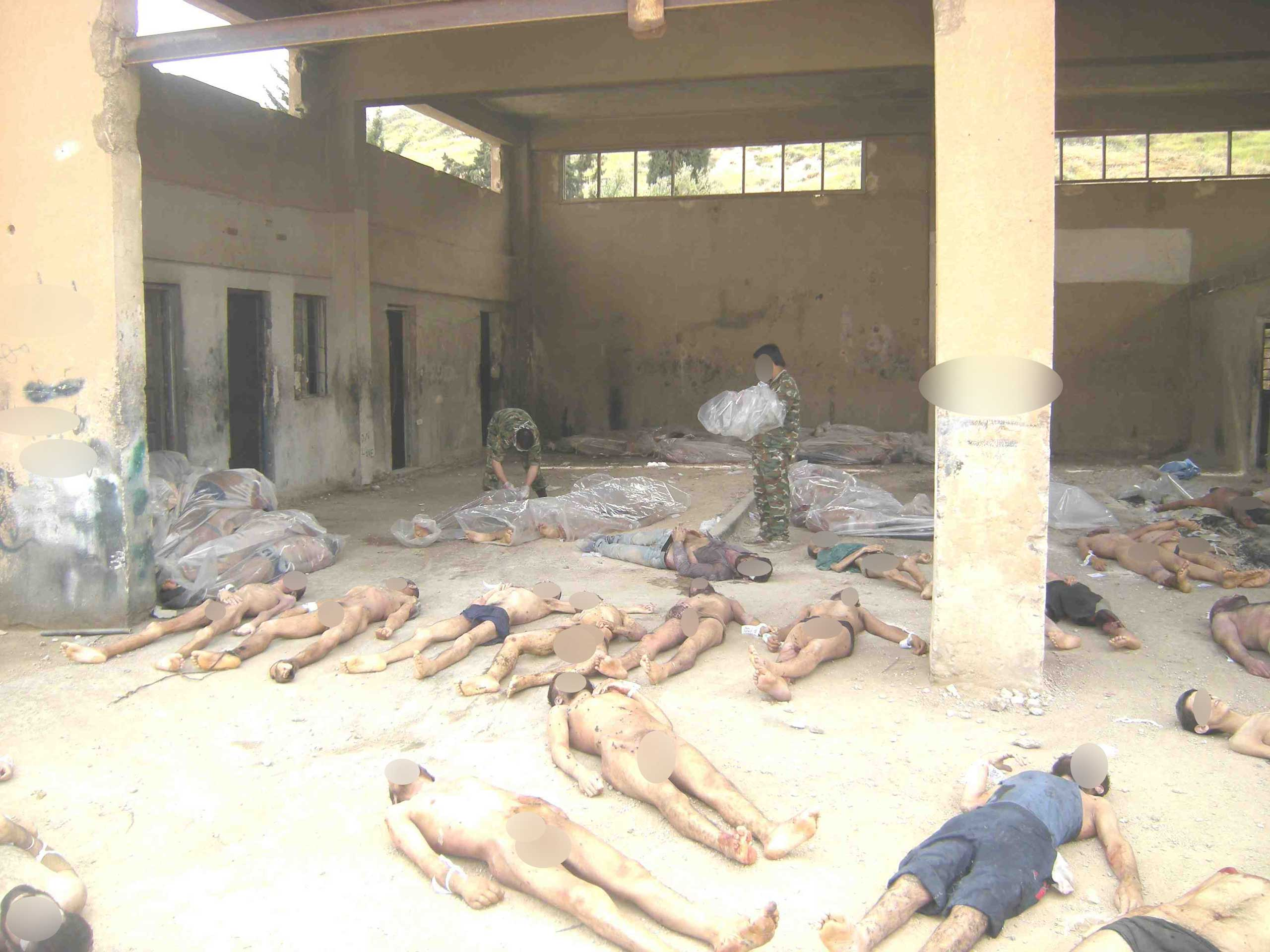 This undated photograph made available following the release of a January 2014 report by the Carter-Ruck law firm, commissioned by the Qatari government, shows evidence of alleged torture and execution at the secret jails of Syria's president, Bashar al-Assad.