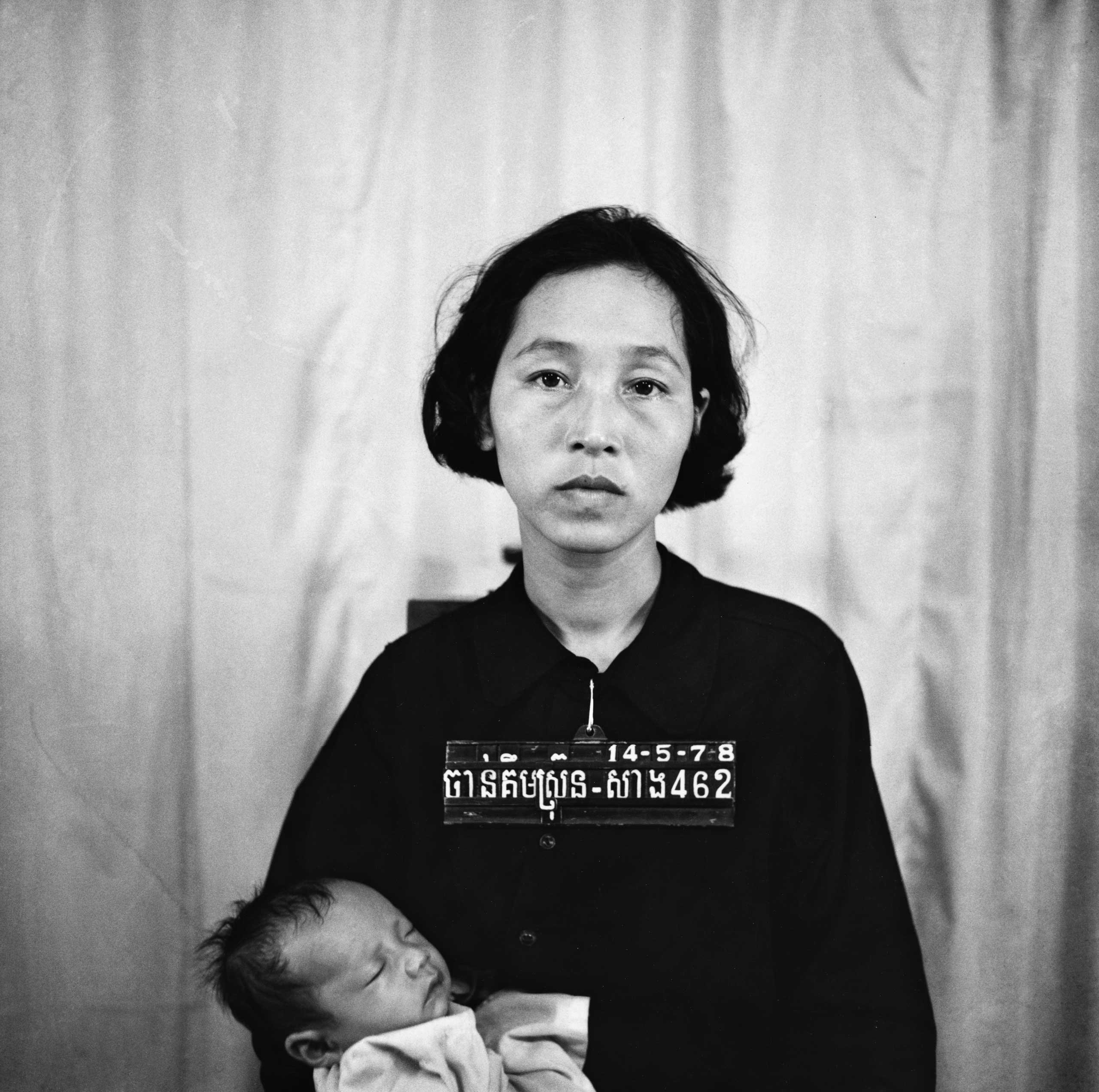 Chan Kim Srung, a prisoner suspected of crimes against Pol Pot's regime photographed while being checked in at the S-21 death camp in Cambodia, c. 1975-78.