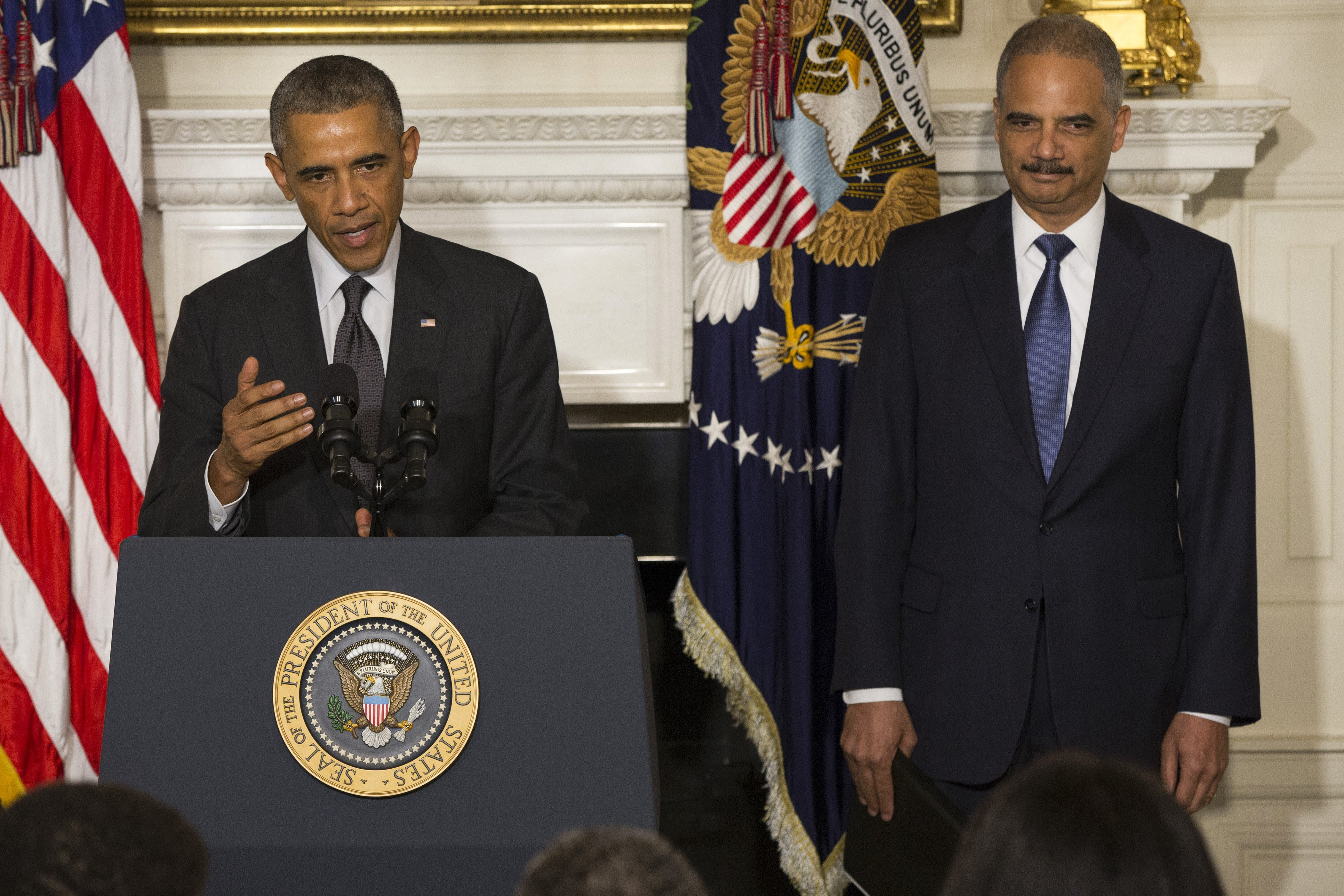 President Barack Obama, accompanied by Attorney General Eric Holder, speaks in the State Dining Room of the White House in Washington, Thursday, Sept. 25, 2014, to announce Holder is resigning.