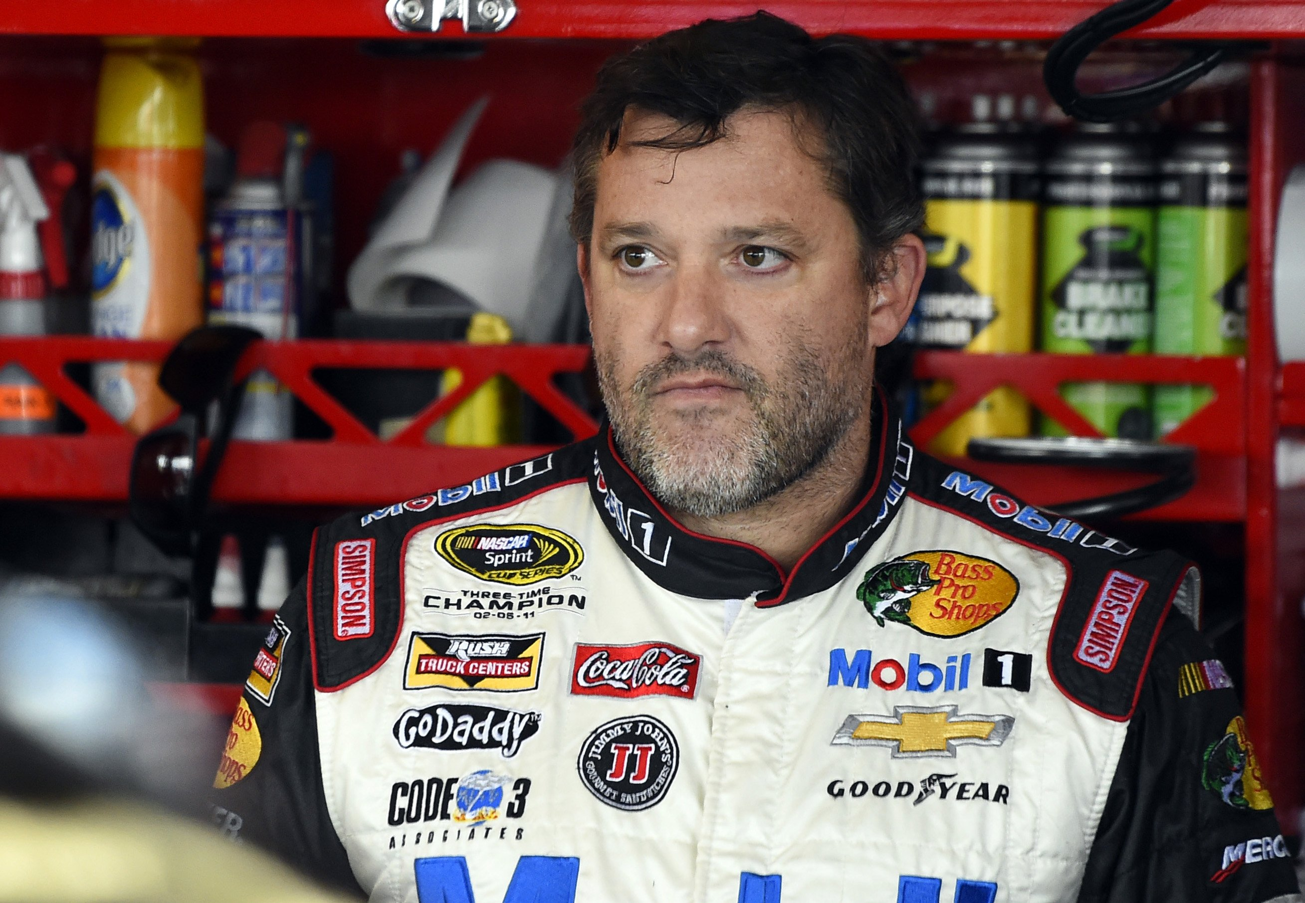 NASCAR driver Tony Stewart (14) looks out from his garage during a practice for the NASCAR Sprint Cup Series auto race at Chicagoland Speedway in Joliet, Ill. on Sept. 13, 2014.