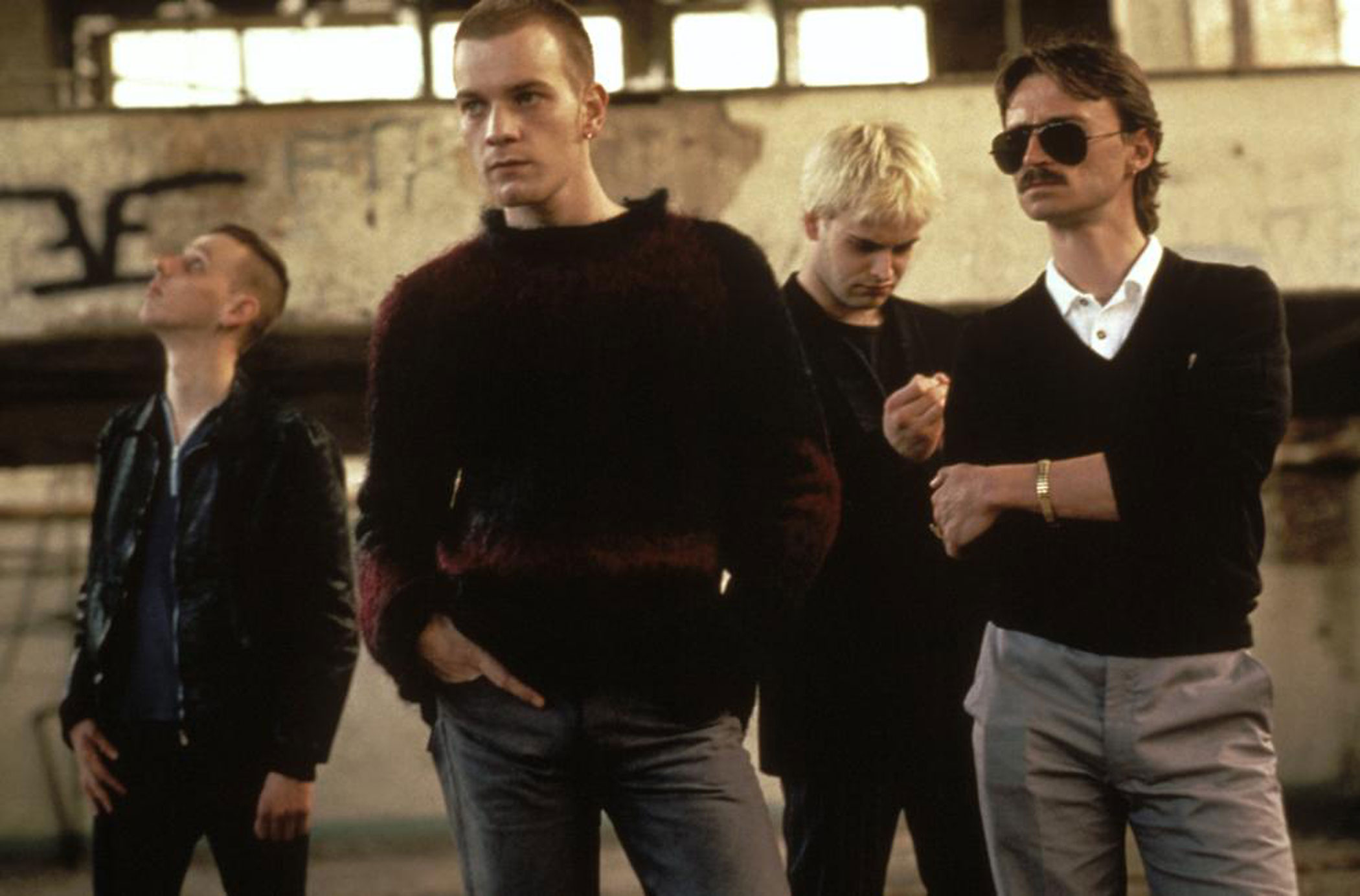 "Trainspotting, 1996. Sex, drugs and raucous Ewan McGregor are just a few of the treats in Danny Boyle's film of the novel by Edinburgsian Irvine Welch (and scripted by Glaswegian John Hodge). McGregor is Mark Renton, a heroin addict, self-described ""bad person"" and irresistible scamp making mischief with his mates in this rocket-fueled romp — A Hard Day's Night for the wasted '90s."