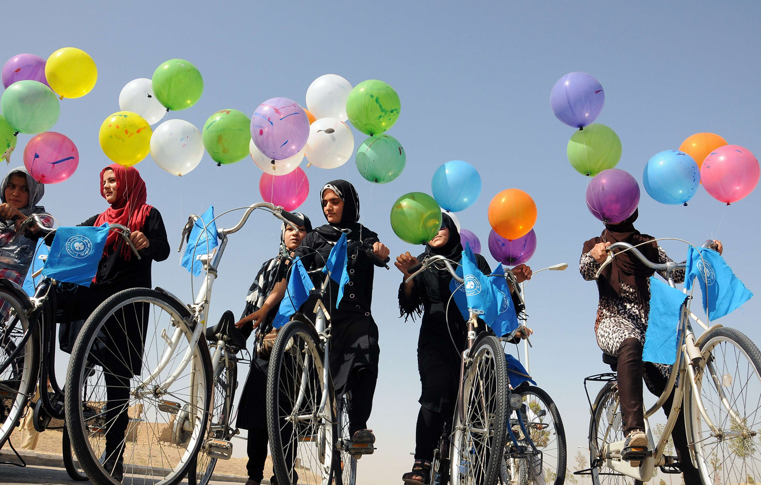 Afghan women take part in a cycling race during World Peace Day in Mazar-i-sharif, Afghanistan on Sept. 21, 2014.