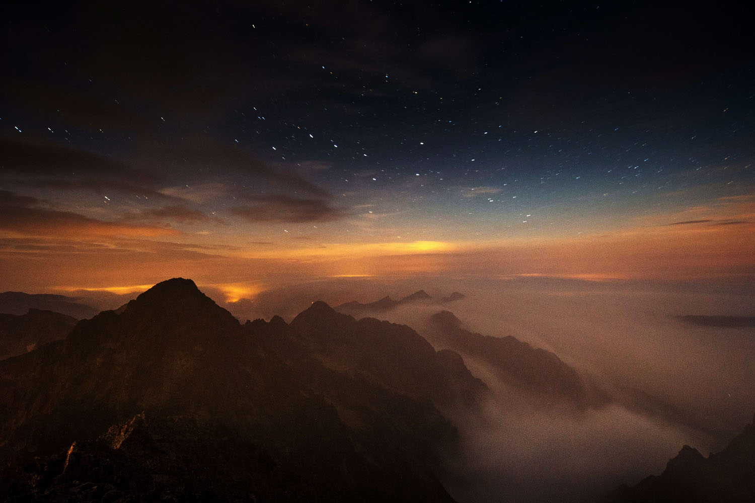 Sept. 4, 2014. A long time exposed picture taken by night shows Slovakia's High Tatras mountains seen from the Solar observatory station on the Lomnicky Stit peak.