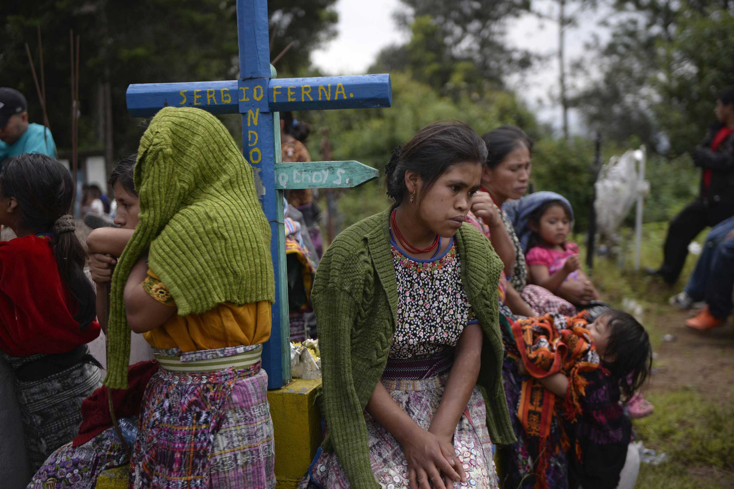 Sept. 22, 2014.                               People attend the burial of Juan Jose Pacoj and Justo Raxon, two of the 11 indigenous people who died in recent clashes between neighbours, in the village of Los Pajoques in San Juan Sacatepequez municipality, 35 km west of Guatemala City.
