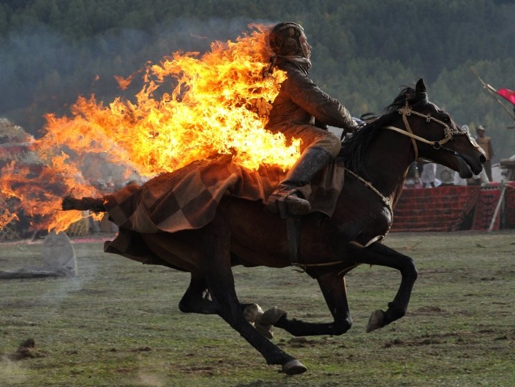 A Kyrgyz stuntman performing during the first World Nomad Games in the Kyrchin (Semenovskoe) gorge, about 300 km from Bishkek on Sept. 10, 2014.