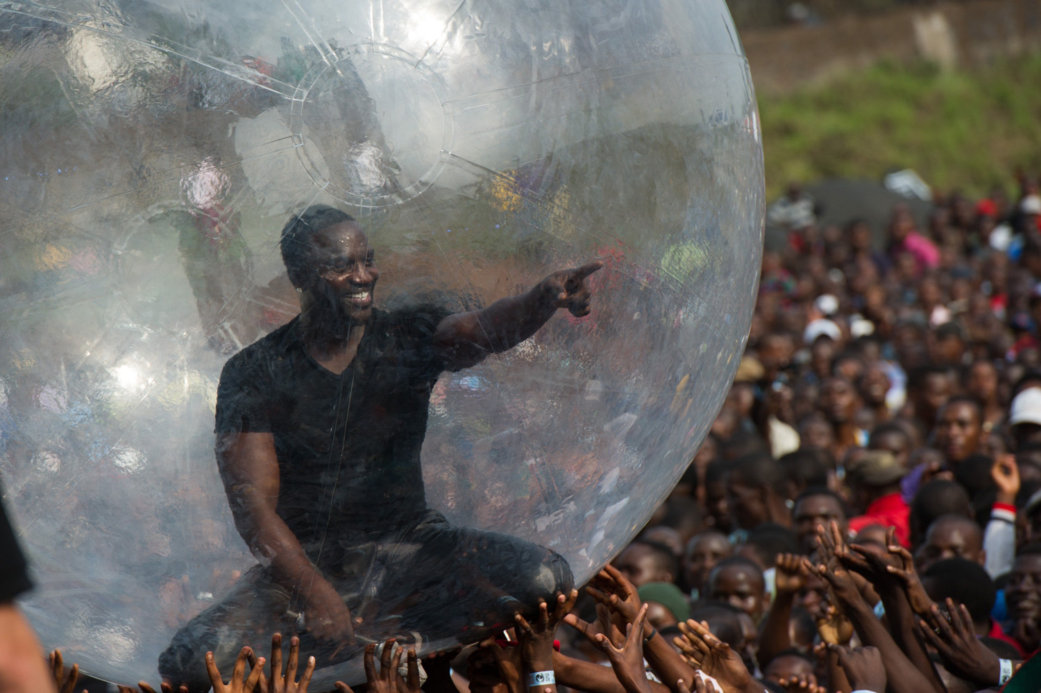 American-Senegalese hip-hop star Akon performs at a concert as part of  Peace One Day  celebrations on International Peace Day at the airport in Goma in the east of the Democratic Republic of Congo on Sept. 21, 2014.