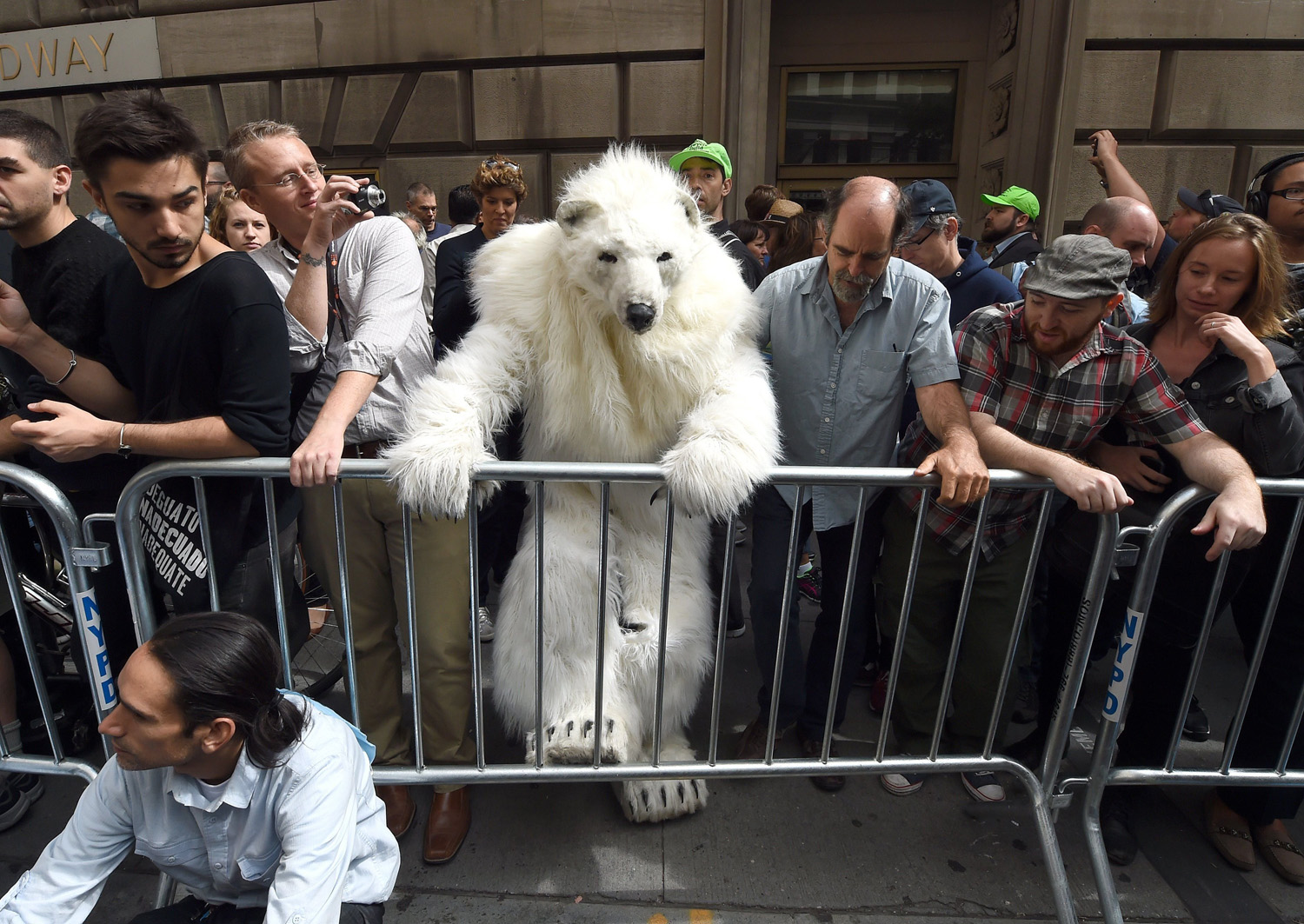 A man dressed as a Polar Bear climbs a barricade as protestors take part in the  Flood Wall Street  demonstrations in New York City on Sept. 22, 2014.