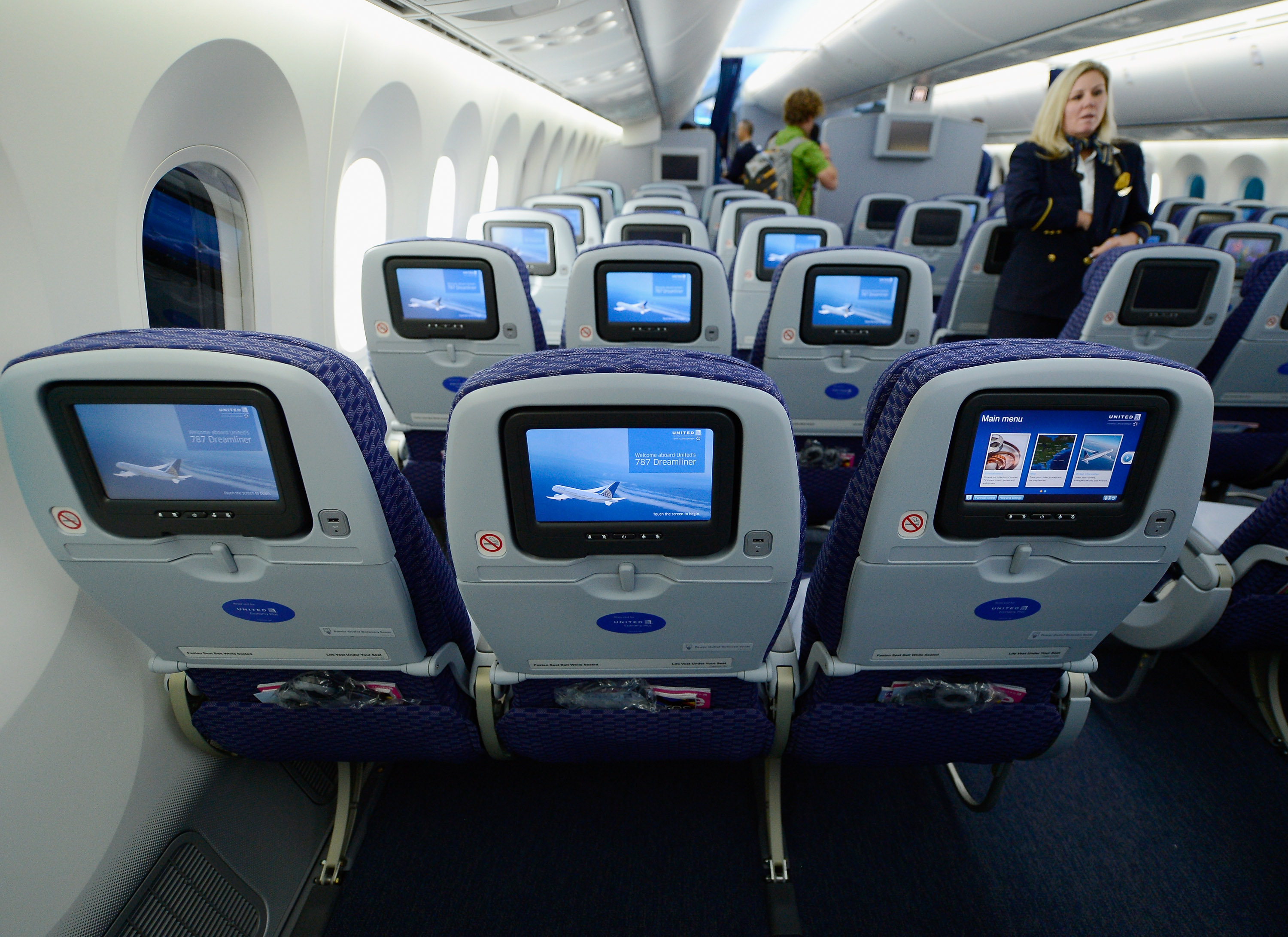 United Airlines flight attendant Tina looks at personal entertainment systems on the new Boeing 787 Dreamliner during a tour of the jet at Los Angeles International Airport on Nov. 30, 2012.
