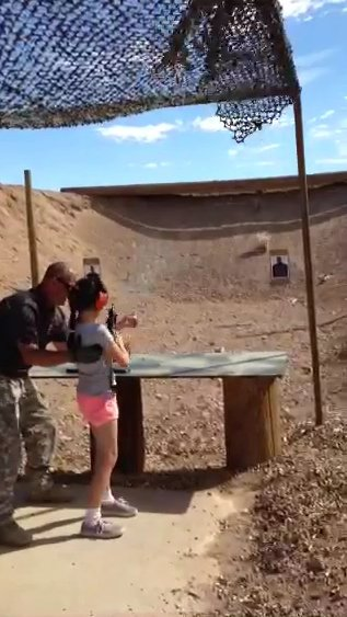In this video screen capture provided by Mohave County, firing-range instructor Charles Vacca, 39, is seen assisting a 9-year-old girl with an Uzi seconds before the weapon recoiled upwards shooting Vacca in the head, at the Last Stop outdoor shooting range onAug. 25, 2014 in White Hills, Arizona.