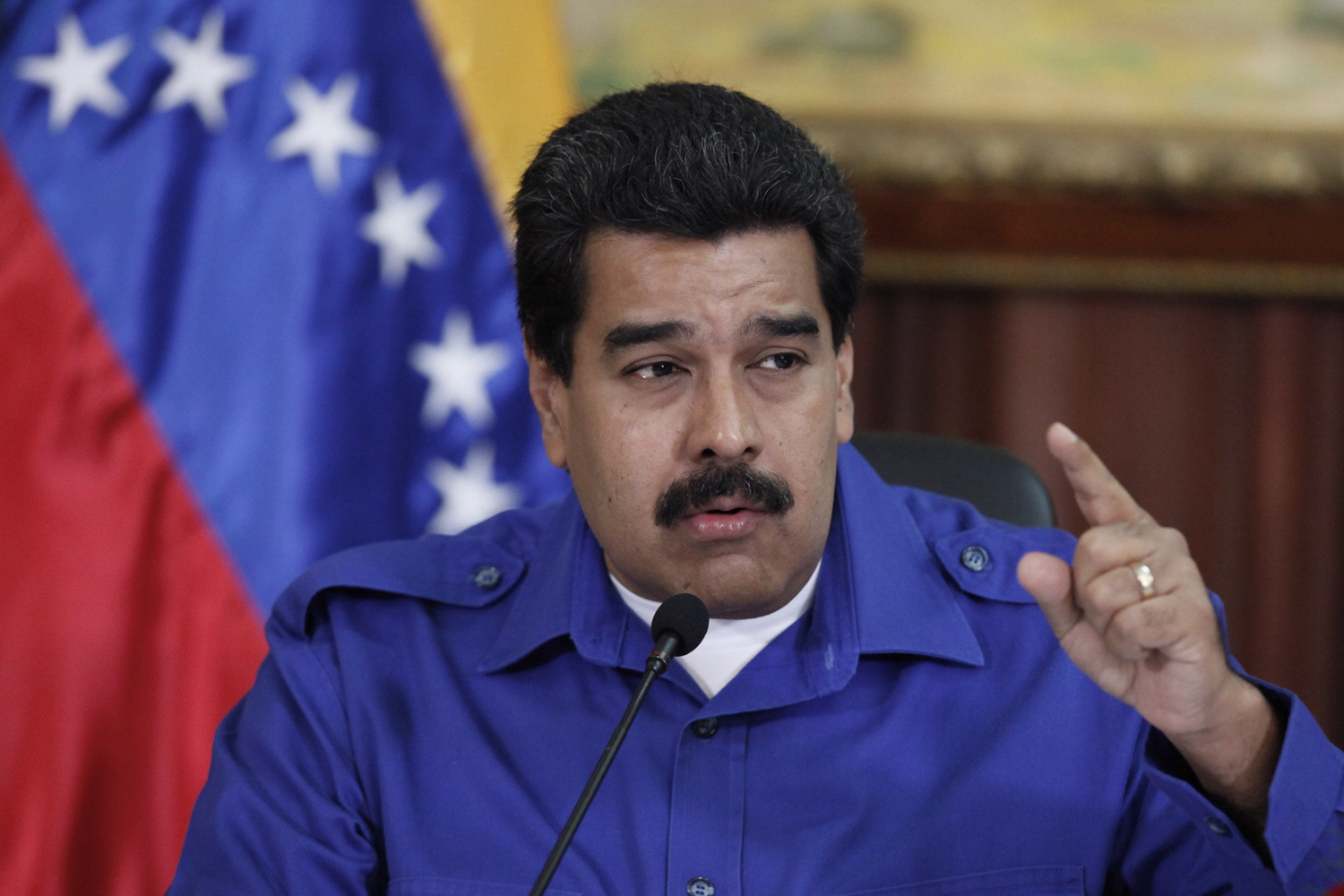 President Nicolás Maduro talks during a meeting with ministers at Miraflores Palace in Caracas, Sept. 3, 2014.