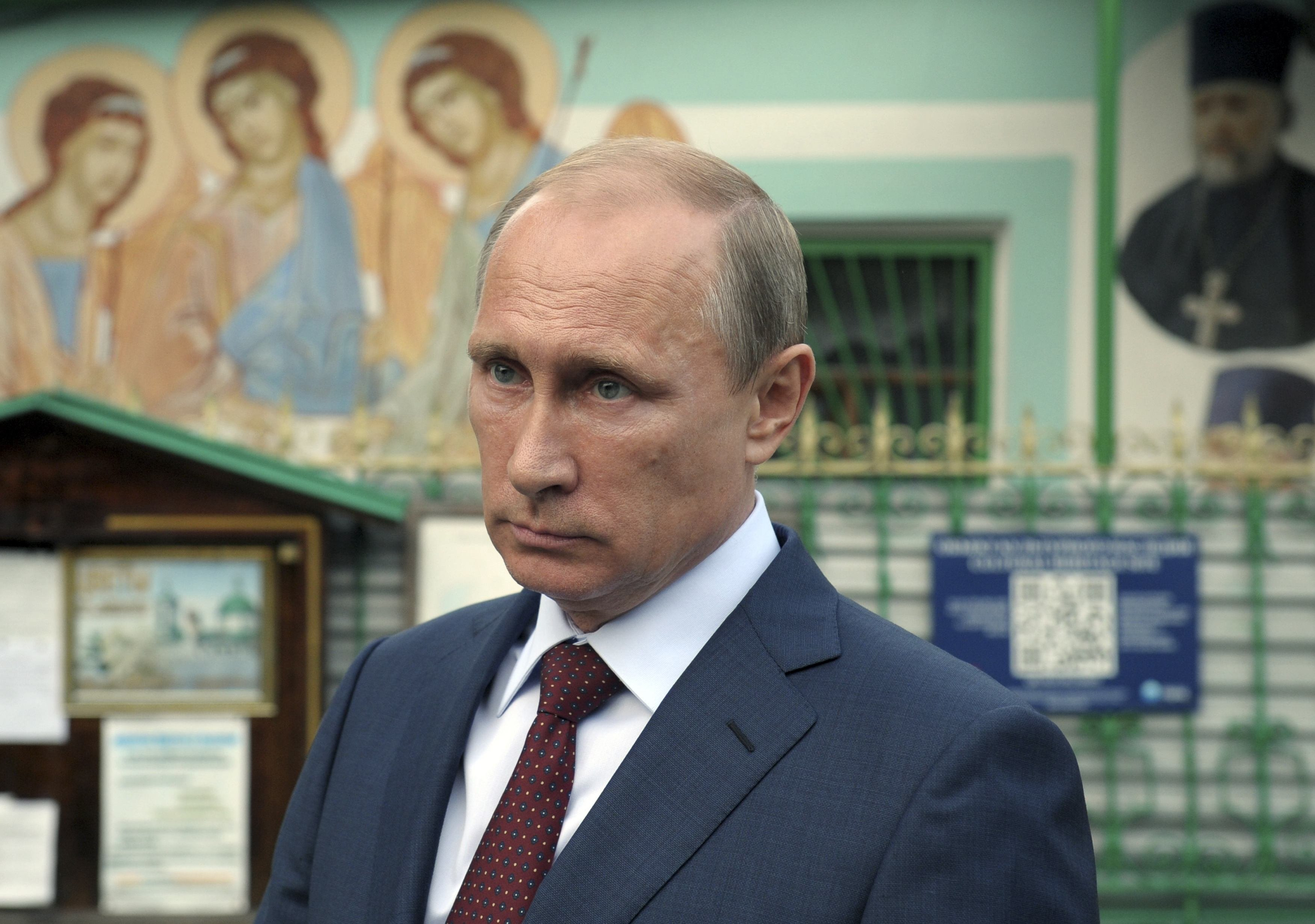 Russian President Vladimir Putin leaves the Life-giving Trinity church in Moscow, Sept. 10, 2014.