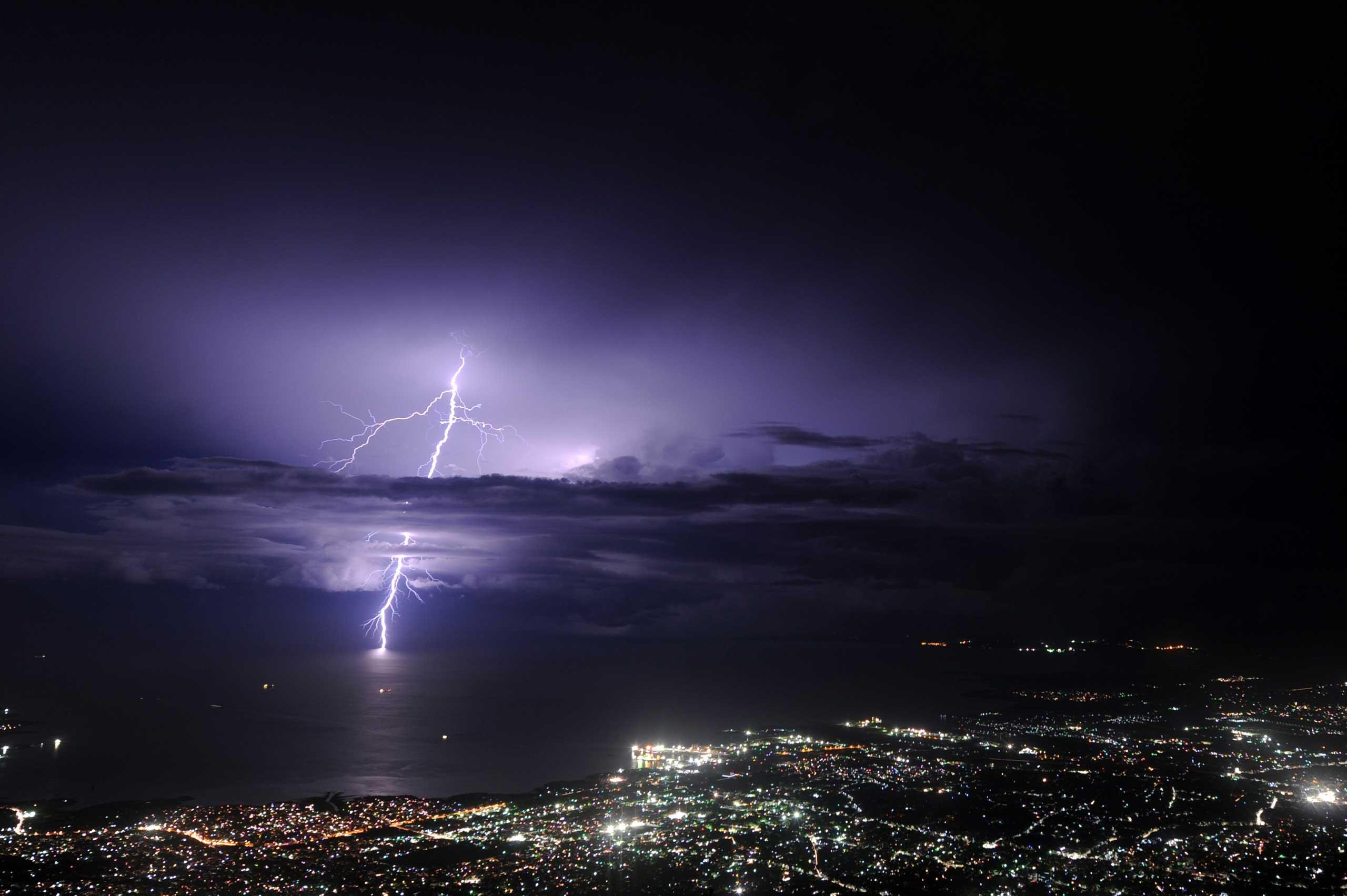 Sept. 24, 2014. Lightning strikes over the sea along the coast of the Haitian capital, Port au Prince.