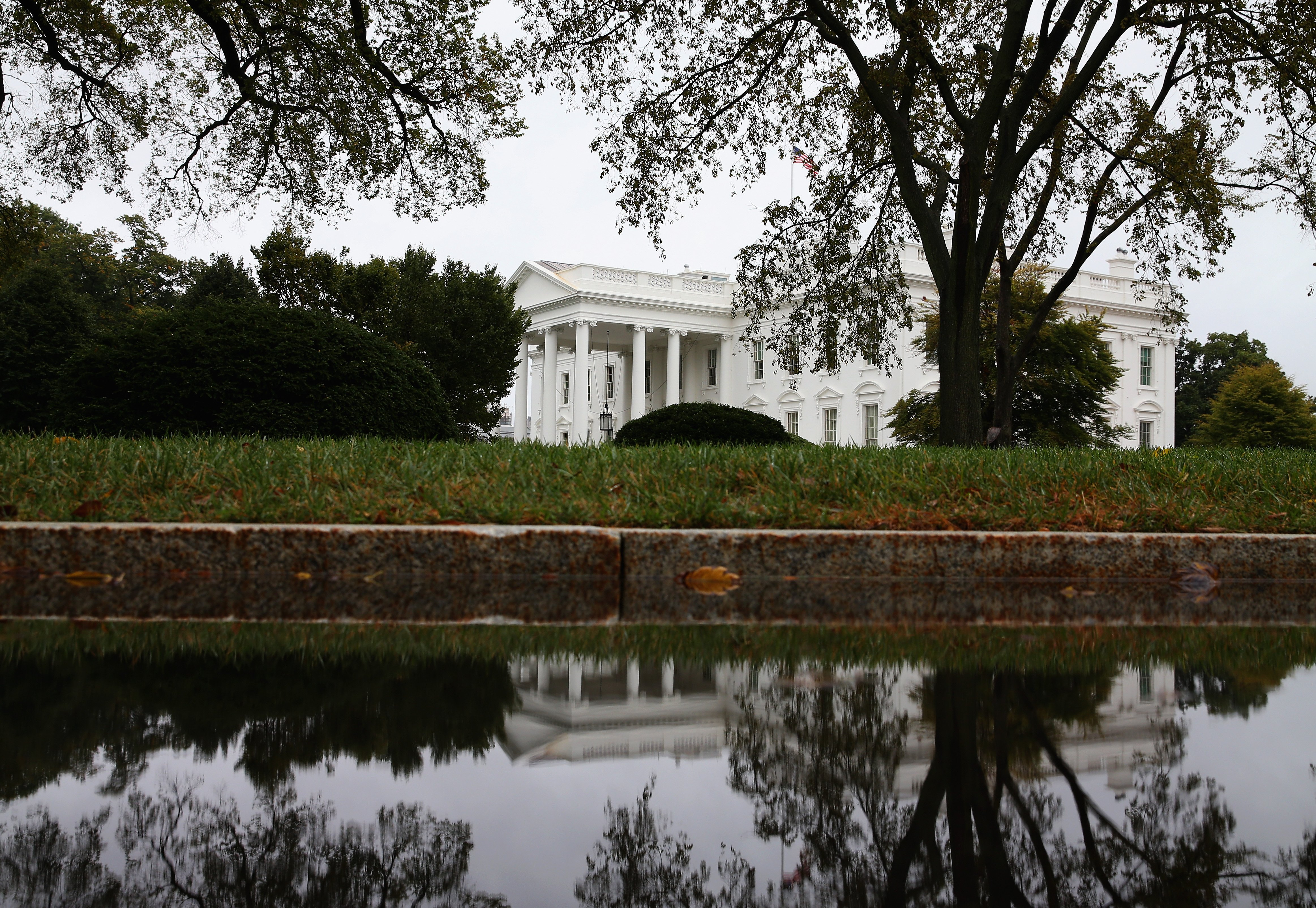 A puddle in the driveway reflects the White House and north lawn on Sept. 25, 2014 in Washington, DC.