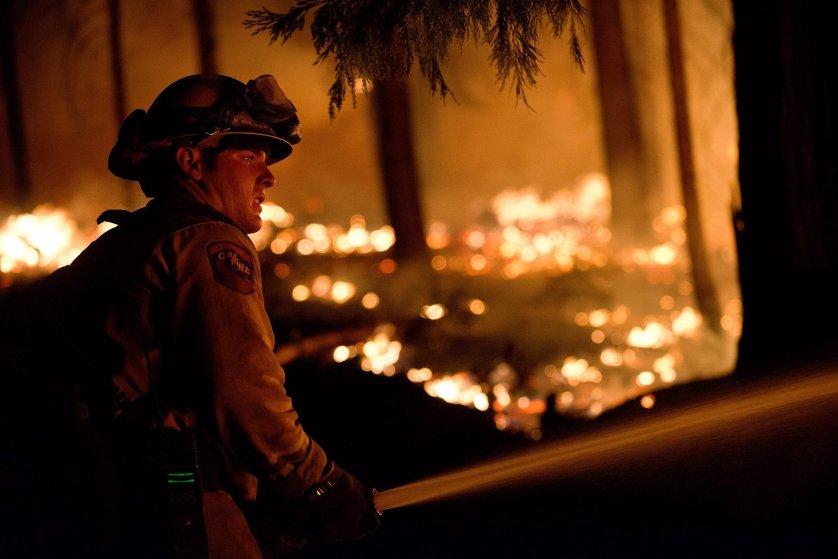 Firefighters battle raging blazes in California
