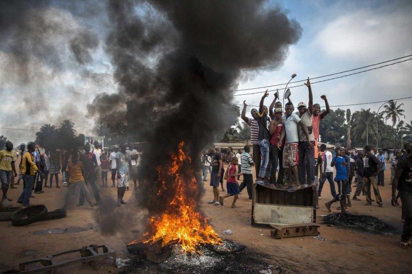 2nd Prize General News Stories. 17 November 2013, Central African Republic. Demonstrators gather on a street in Bangui to call for the resignation of interim President Michel Djotodia following the murder of Judge Modeste Martineau Bria by members of Seleka. Bangui, Central African Republic.