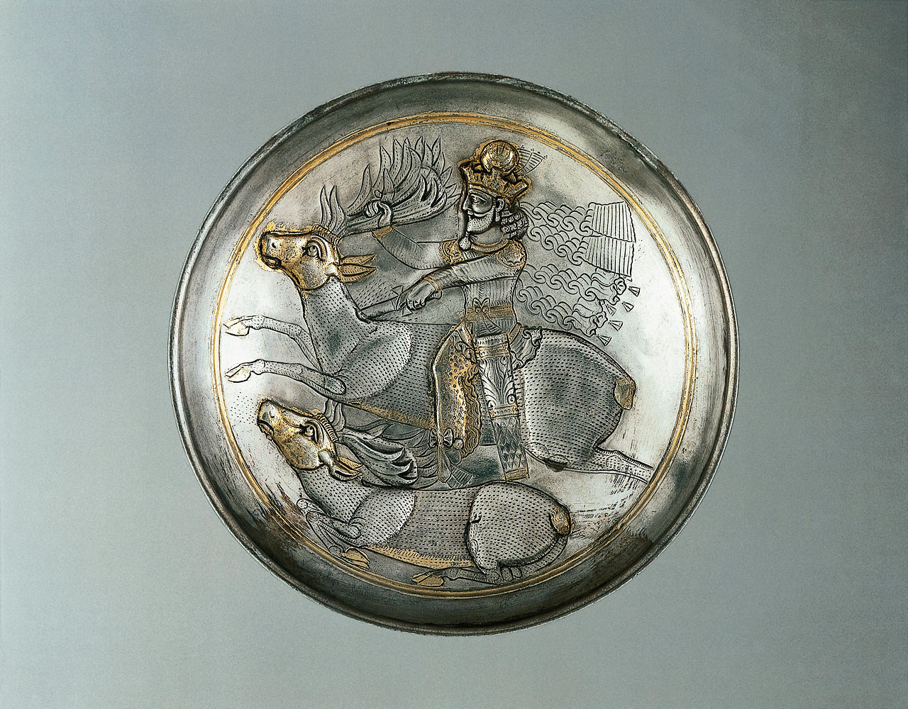 Silver plate, partially gilded, representing king, probably Shapur II hunting deer