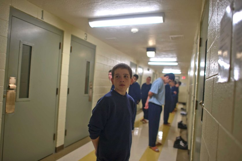 Vinny, 13, stands in command call before entering his cell at the juvenile detention center.